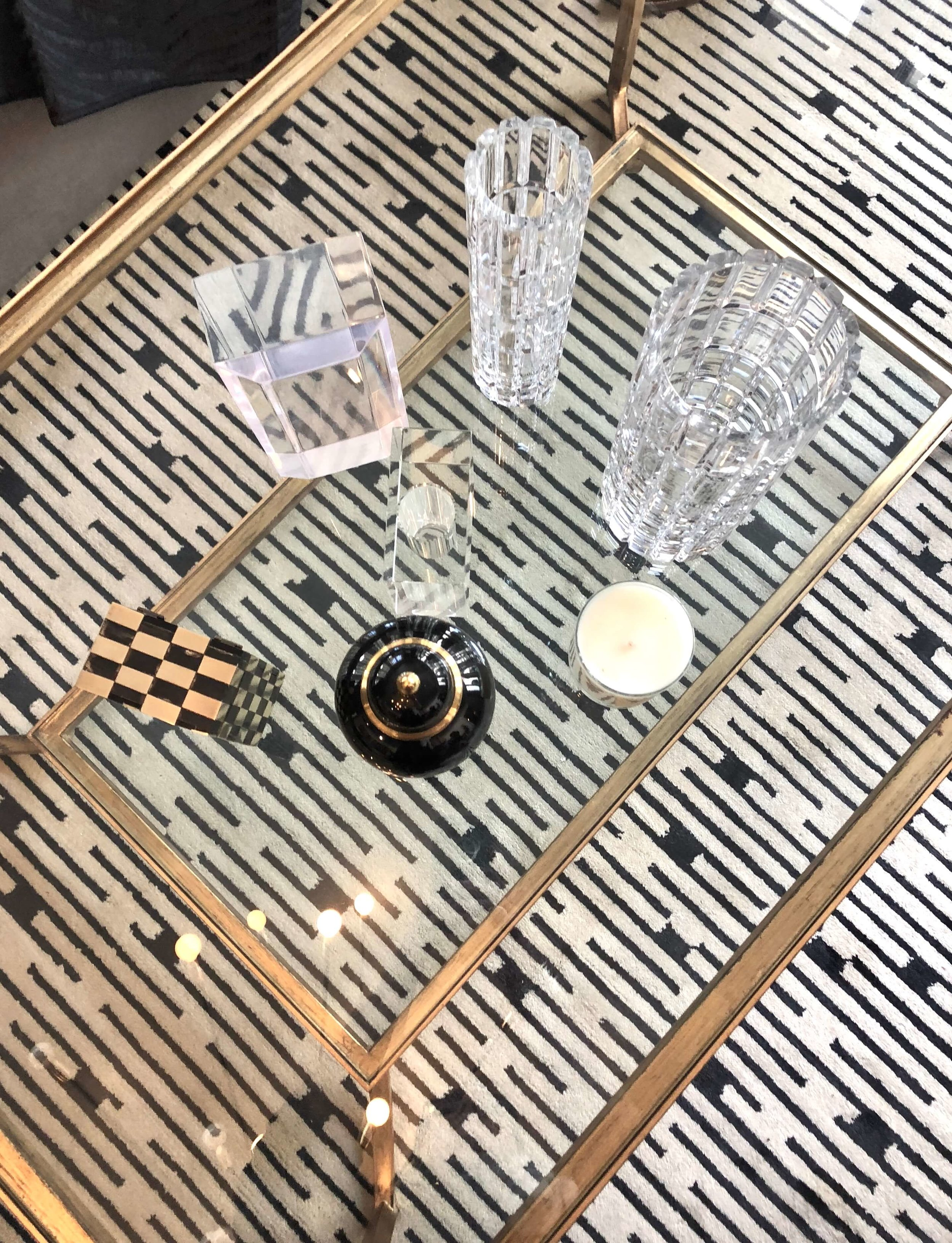 Great striped black and white rug under a glass top cocktail table - Michael Wrusch of Michael Wrusch Designs #coffeetable #blackandwhiterug
