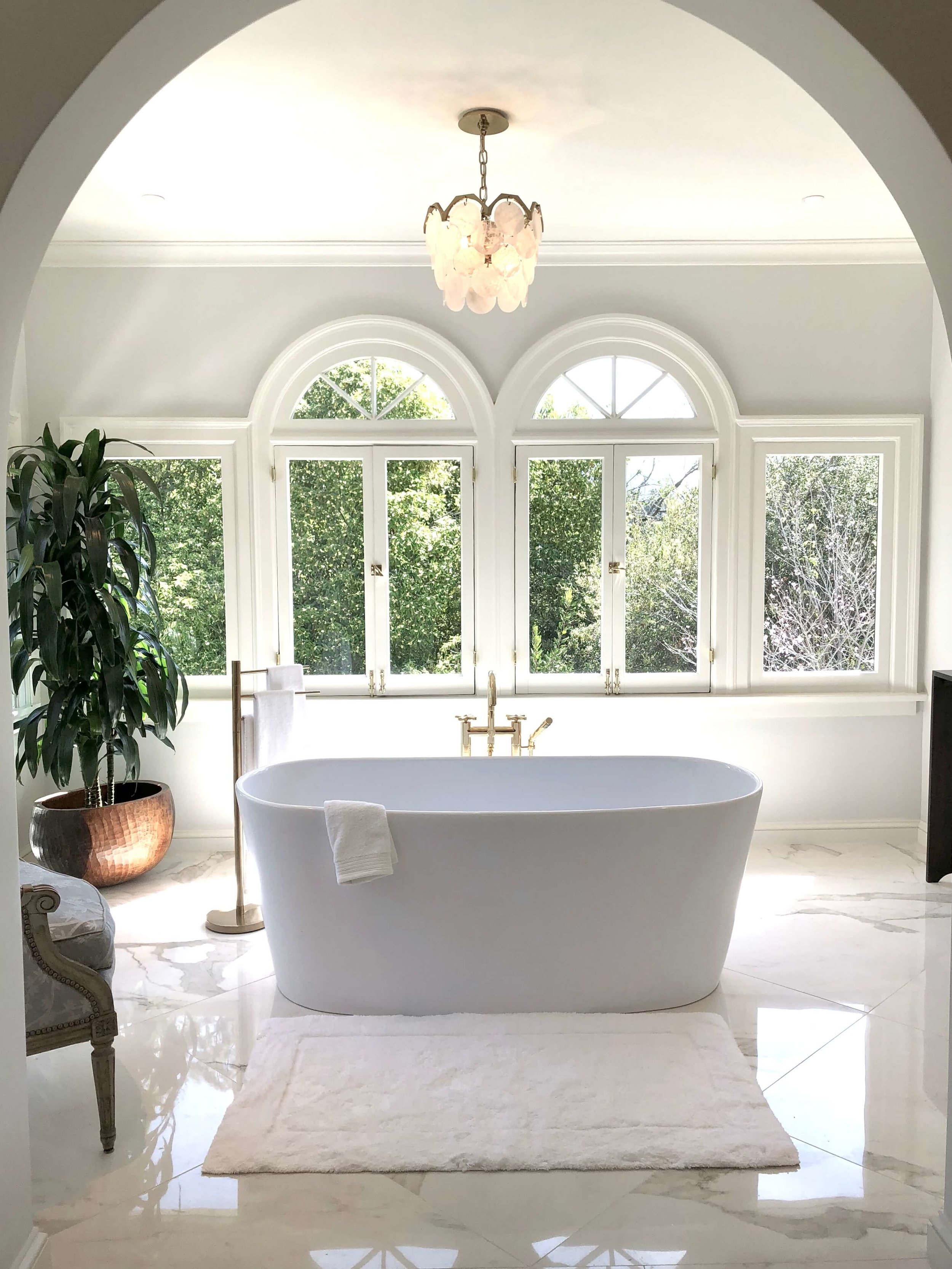Master bathroom w/ free-standing tub and white marble tile floor designed by Parker West Interiors #bathroomdesign #freestandingtub #bathroomremodel #bathroomdesignideas