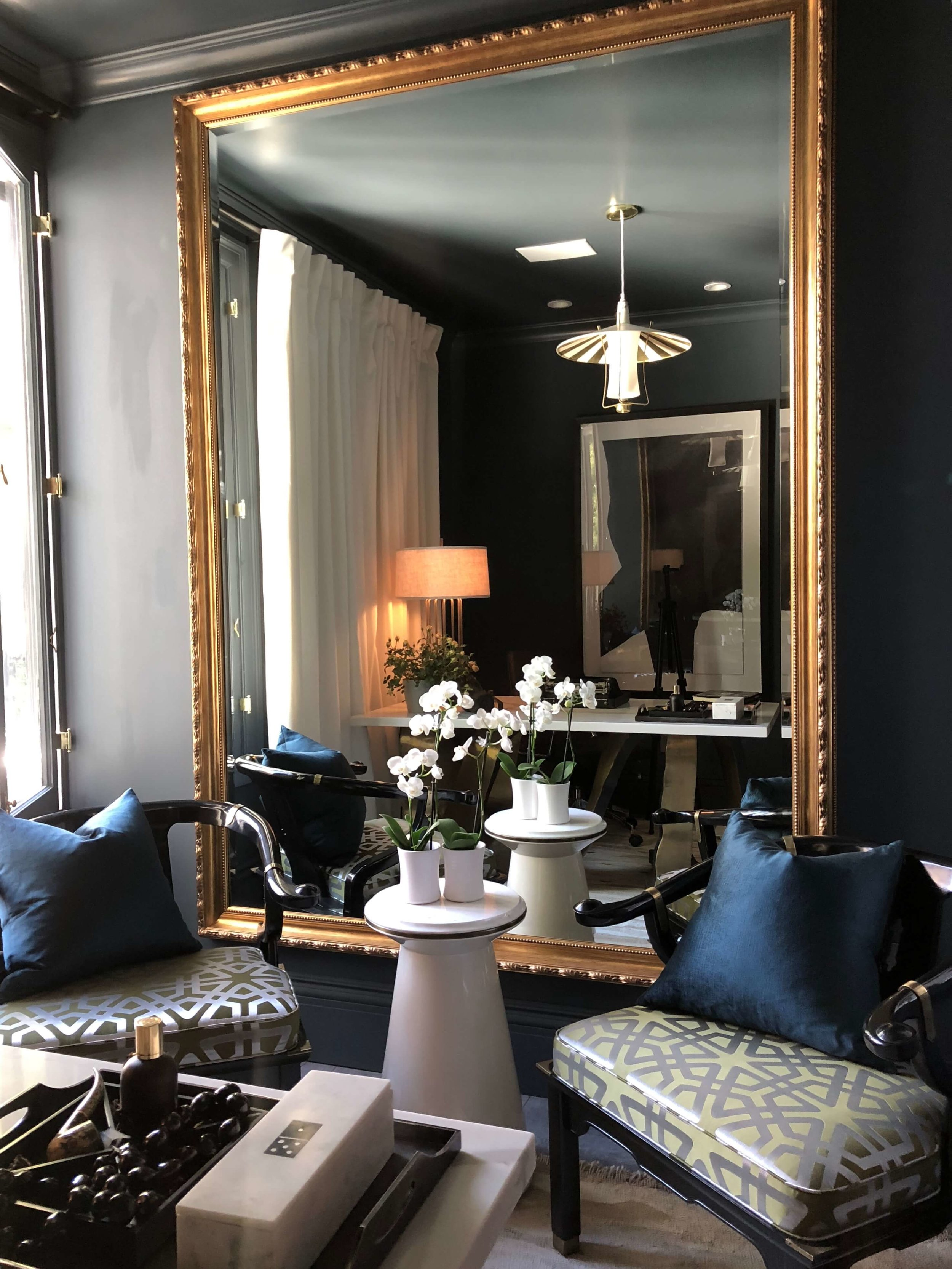 Modern Man's Retreat designed by Xander Noori, with oversized mirror and dark gray walls #study #homeoffice #masculinedesign #mancave