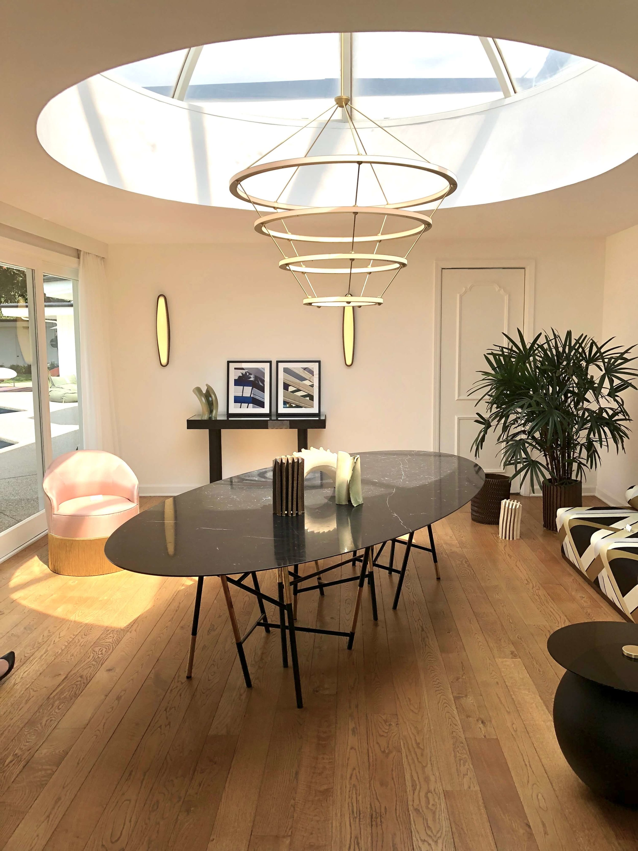 Oculus skylight with lighting designed by Paul Loebach in dining room of Casa Perfect, Beverly Hills, CA #oculus #skylight