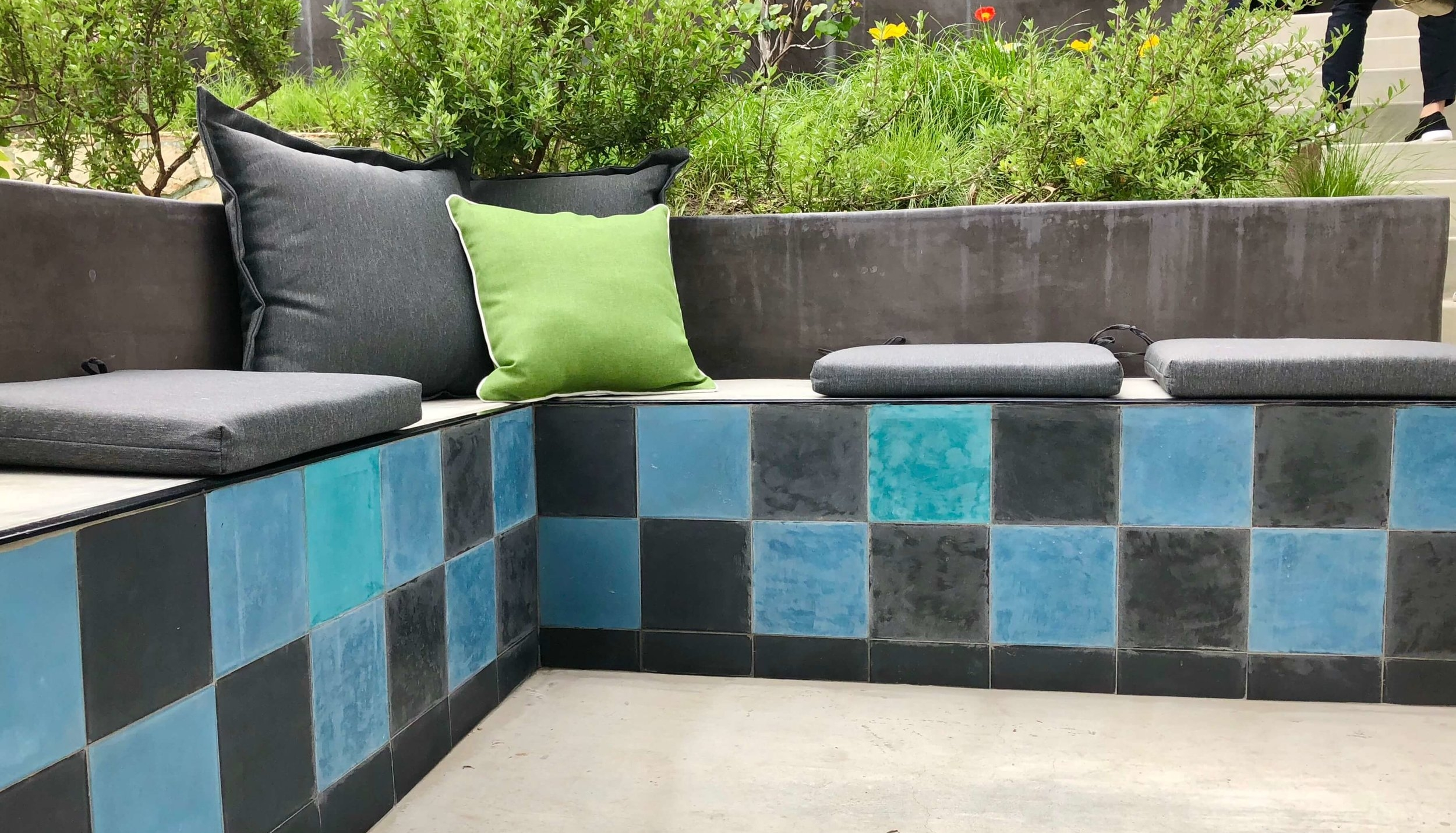 blue and gray tiled concrete outdoor bench