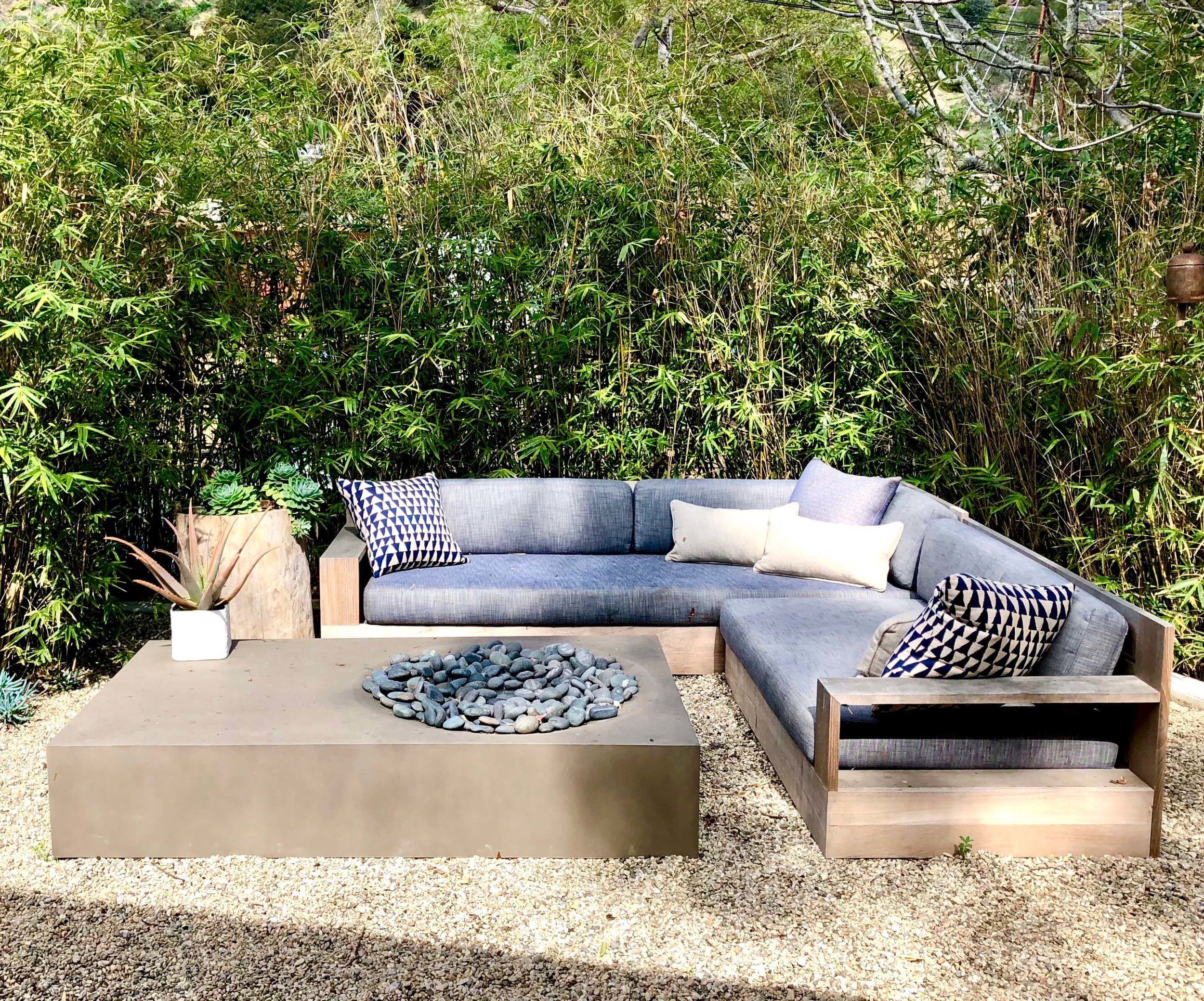 Outdoor living sectional with firepit coffee table seen at Dwell on Design home tour #outdoorliving #outdoorseating