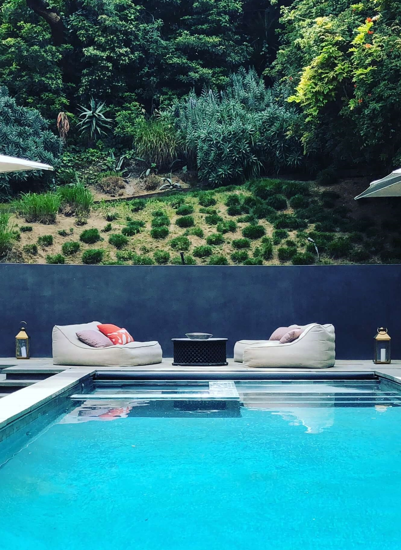 Poolside lounge seating at Dwell on Design home tour -  Assembledge+ Architects  #poolside
