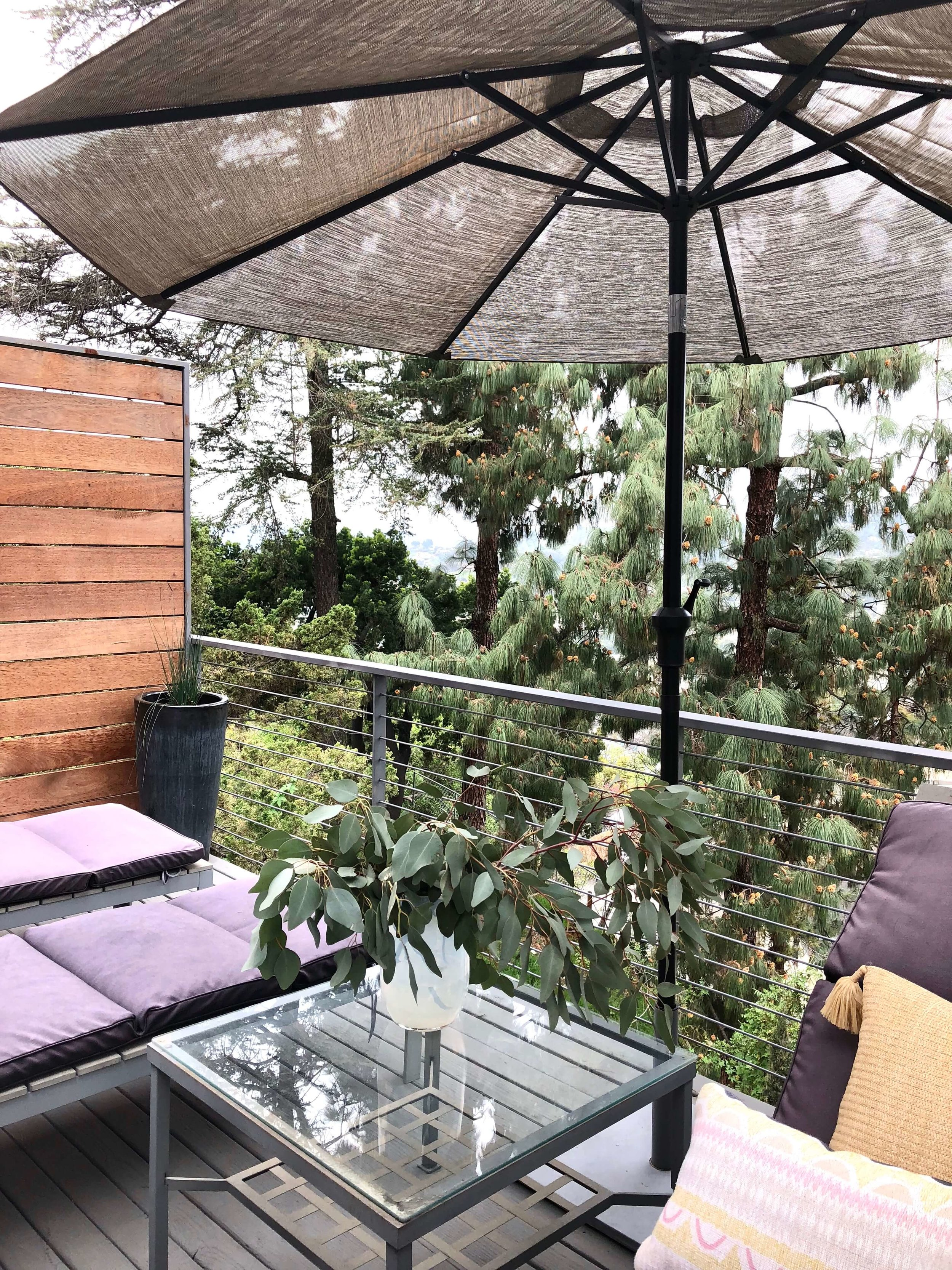 A balcony deck up the treetops on a hillside in LA - Dwell on Design home tour #deck #outdoorliving