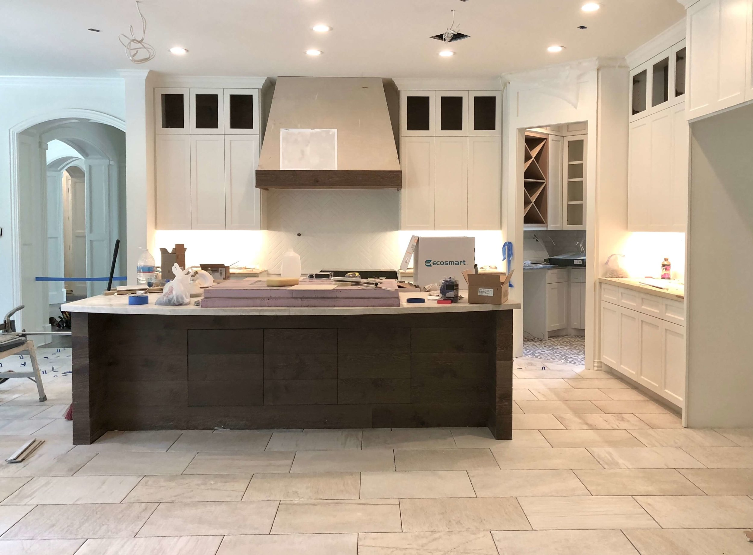 Kitchen remodel in progress with white cabinetry and wood tone kitchen island | Carla Aston, Designer #kitchenremodel #kitchenisland