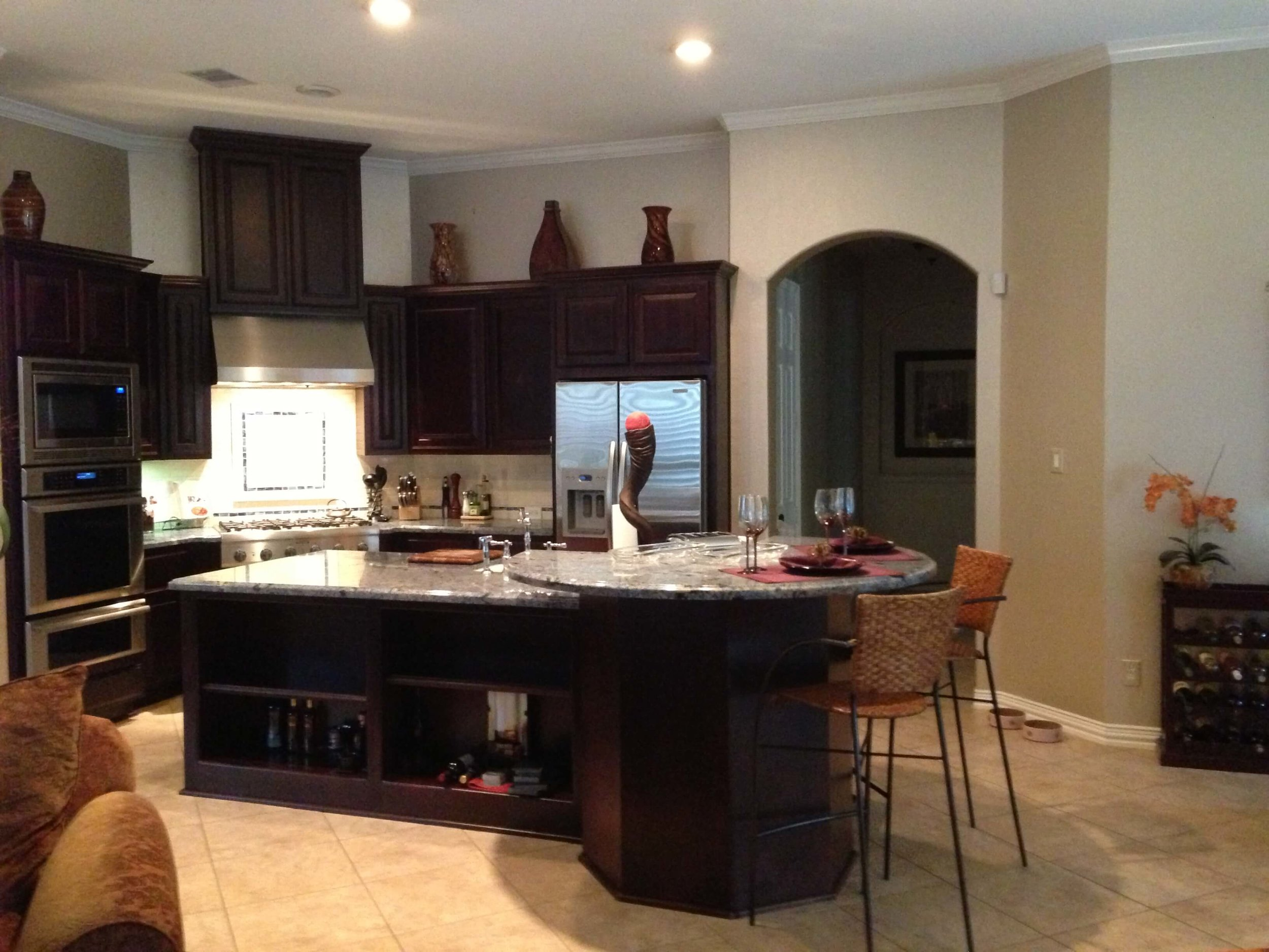 Before kitchen remodel with high bar shape on one end