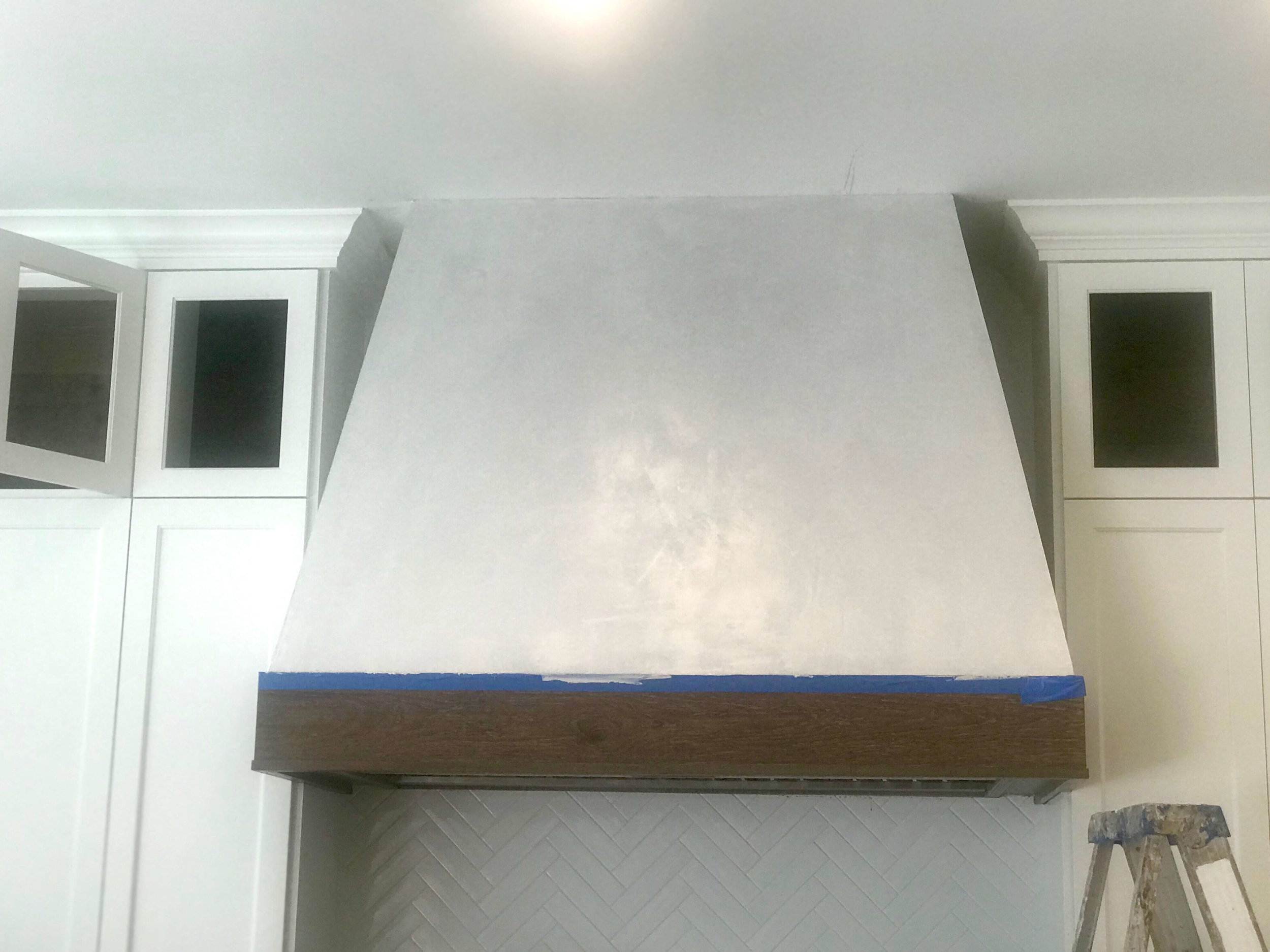 Here's the beautiful plaster finish going on the hood. It's a subtle tone-on-tone effect, designed to reflect the same look as the quartzite countertops and the flooring. :-) Looking good! Carla Aston, Designer #kitchenhood