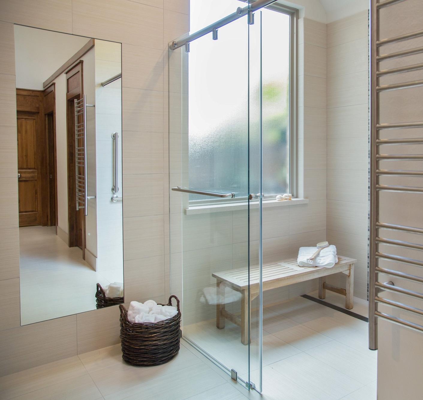 Tile runs from bathroom into shower | Designer: Carla Aston, Photographer: Tori Aston