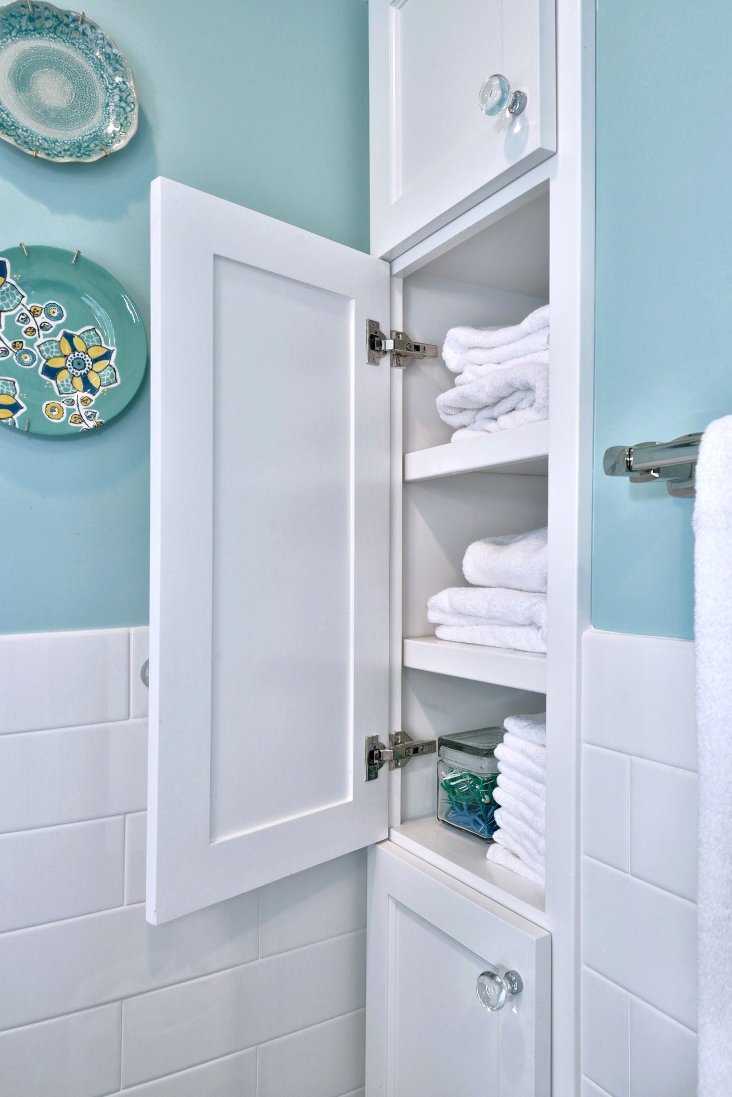 Small linen cabinet built into wall space found upon demolition | Designer: Carla Aston, Photographer: Miro Dvorscak