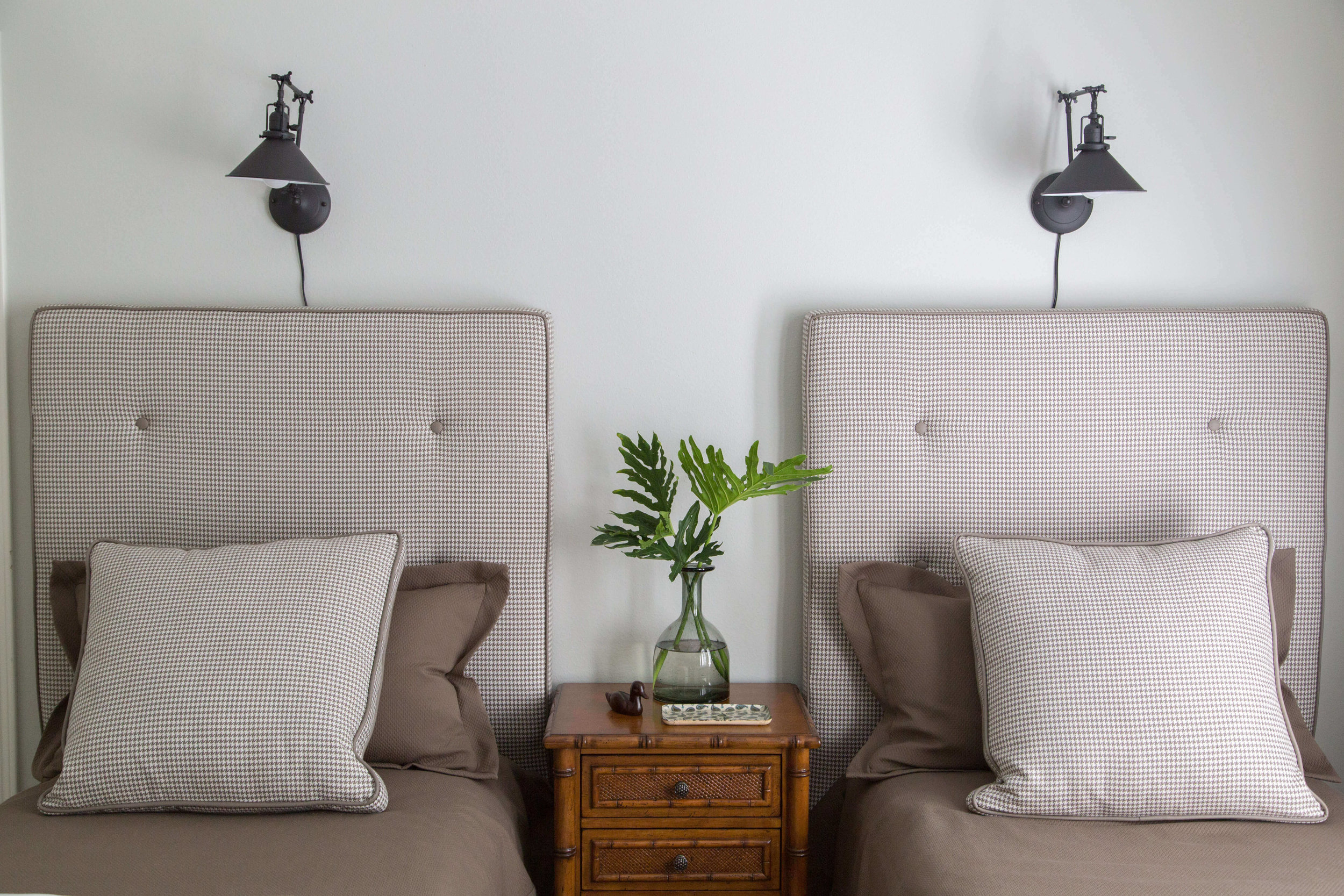 win upholstered headboards with lights above | Designer: Carla Aston