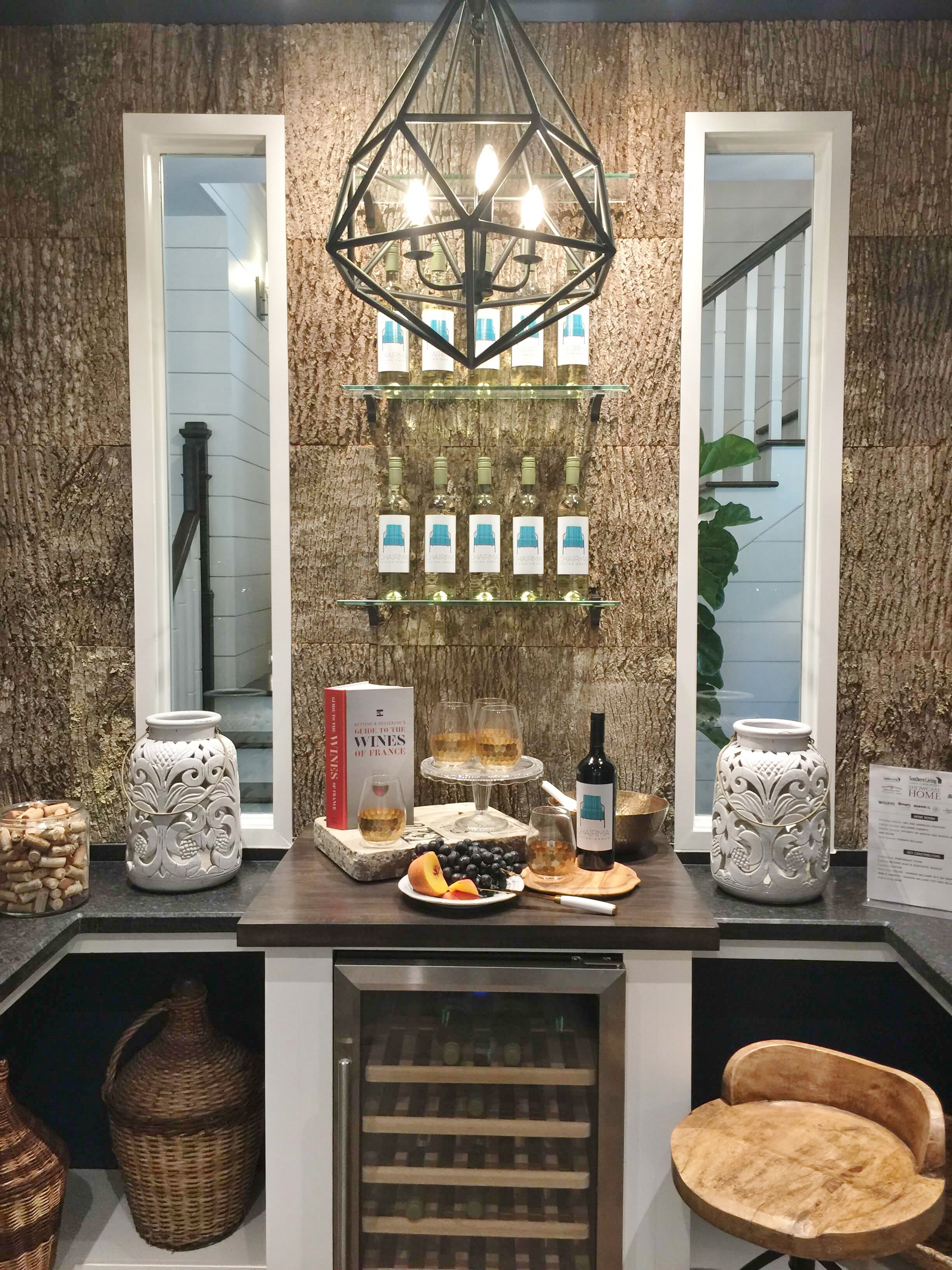 Southern Living Showcase Home- Wine room with real bark panels, Designed by Chairma Design Group  #wineroom
