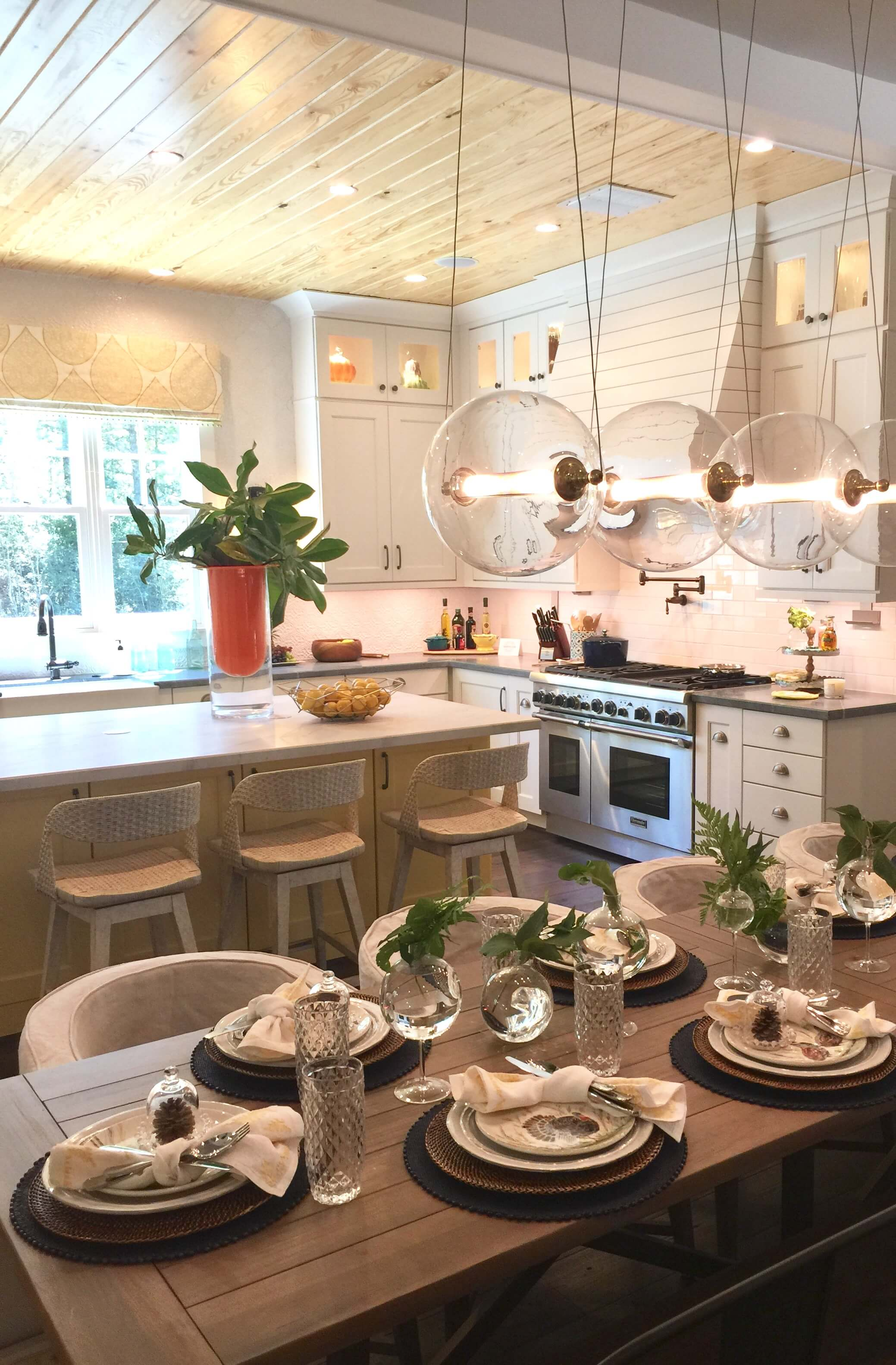 Southern Living Showcase Home - Kitchen with shiplap hood and ceiling and yellow island, Designed by Chairma Design Group #kitchenisland #kitchendesignideas