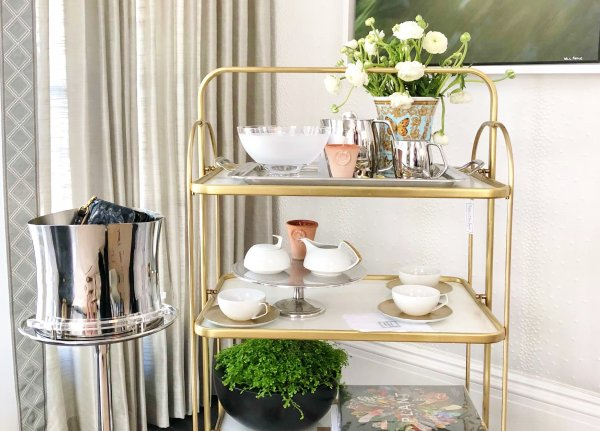 Brass barcart in dining room of Pasadena Showcase House of Design - Designer: Elizabeth Lamont