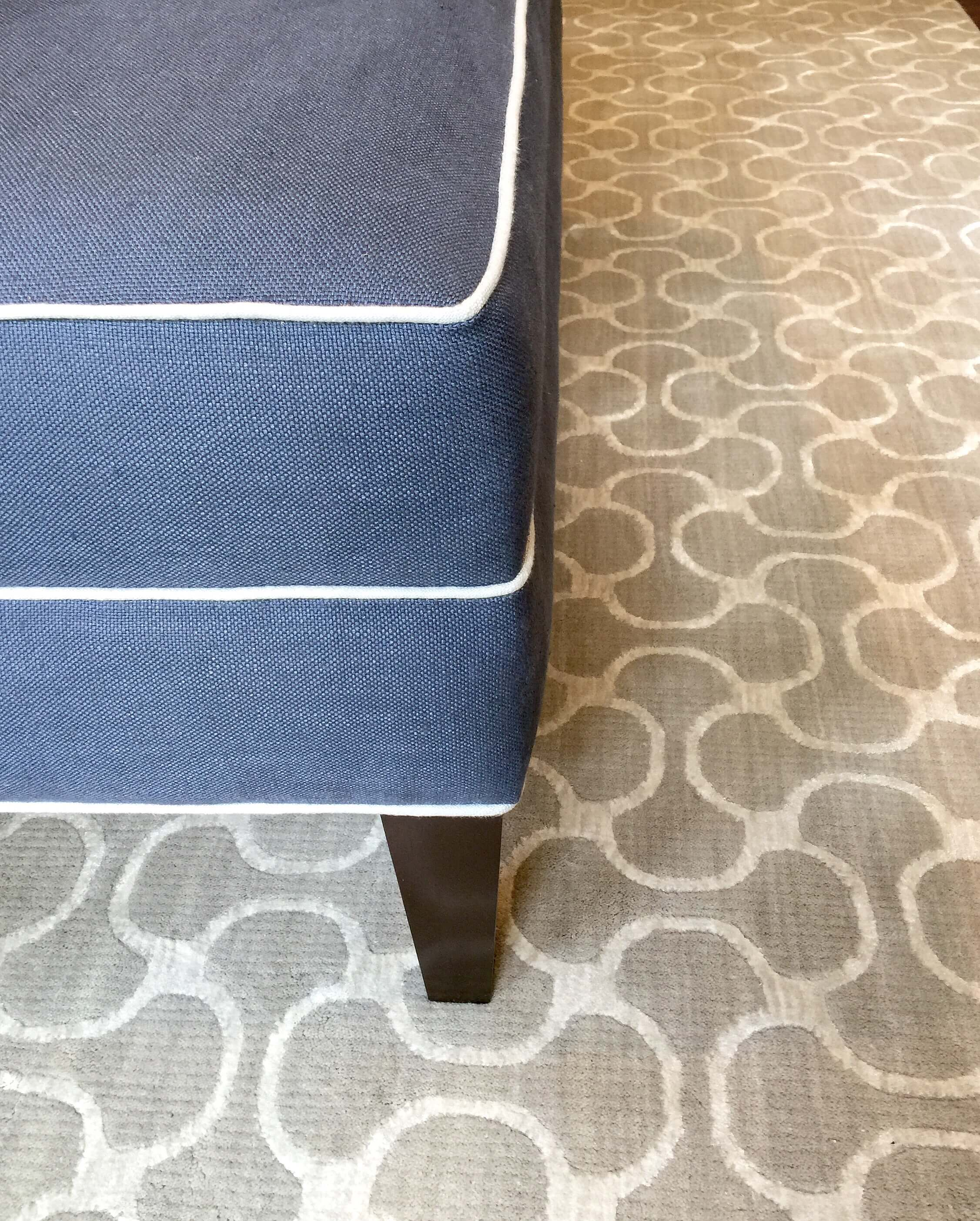 Custom ottoman details with contrasting welting #ottoman