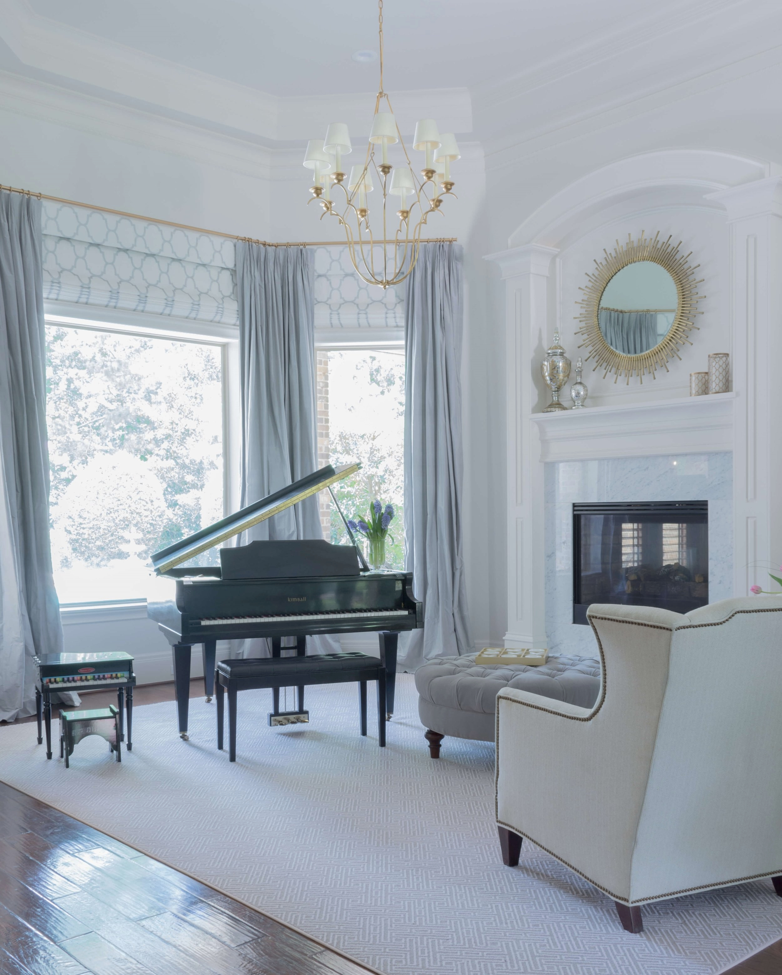 Making a formal living room a little more child-friendly | After - Living Room with baby grand piano and marble fireplace and gilded chandelier | Designer: Carla Aston, Photographer: Charles Behrend #livingroomideas #livingroom