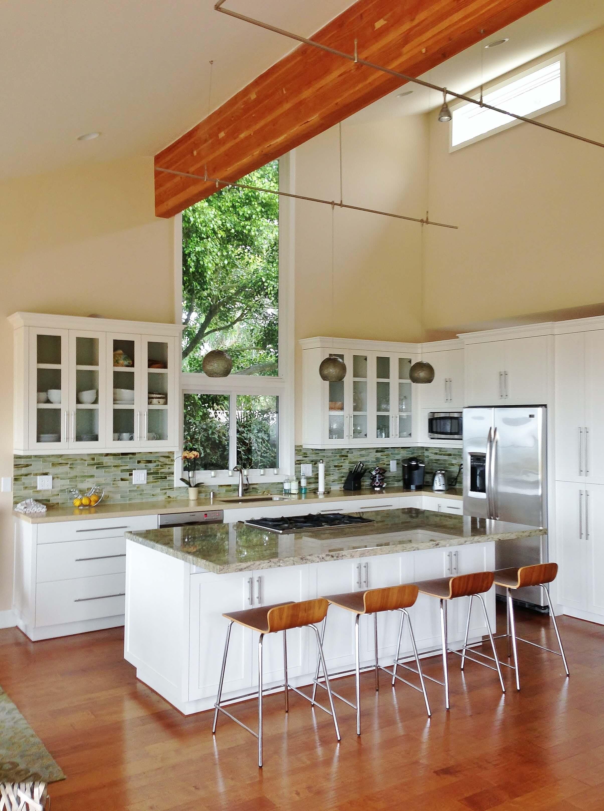 White kitchen cabinets with glass backsplash tile - Ventura California rental house review tour