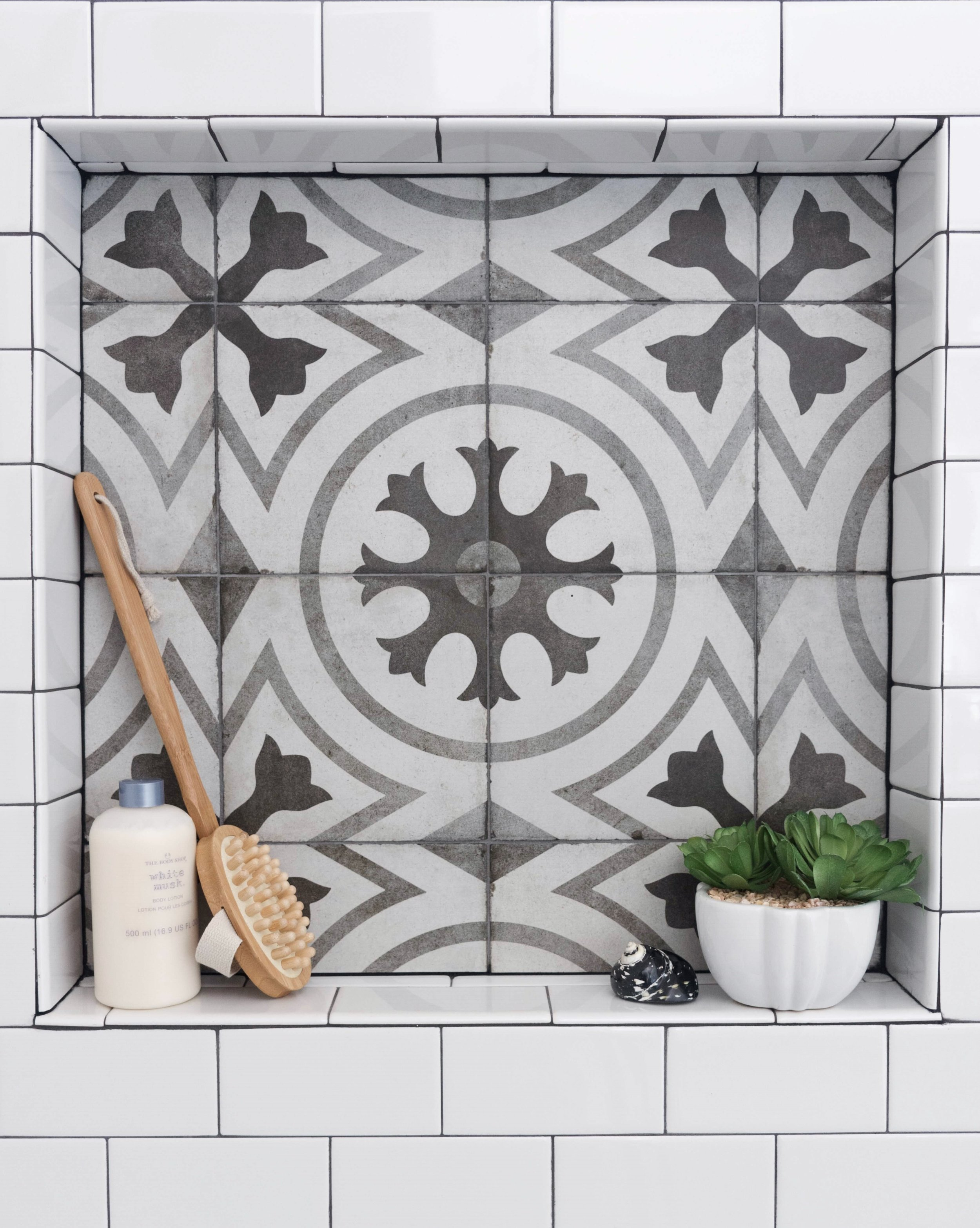BEFORE AND AFTER - Master bathroom remodel, new shower with cement look tile shampoo niche, white subway tile with dark grout | Carla Aston, Designer | Charles Behrend, Photographer #cementtile #shampooniche #showerniche #subwaytile #bathroomremodel