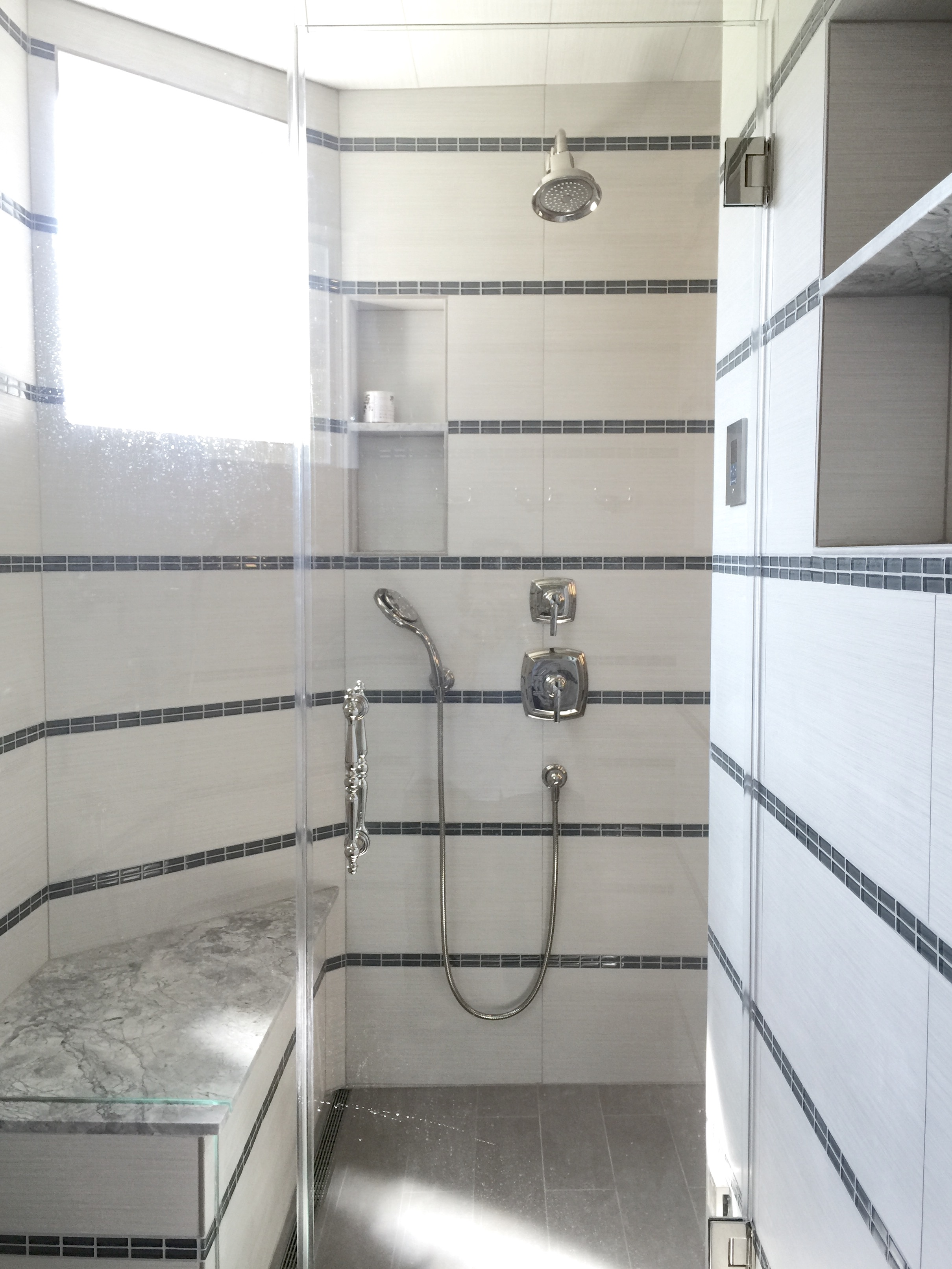 Steam shower within a shower stall | Designer: Carla Aston