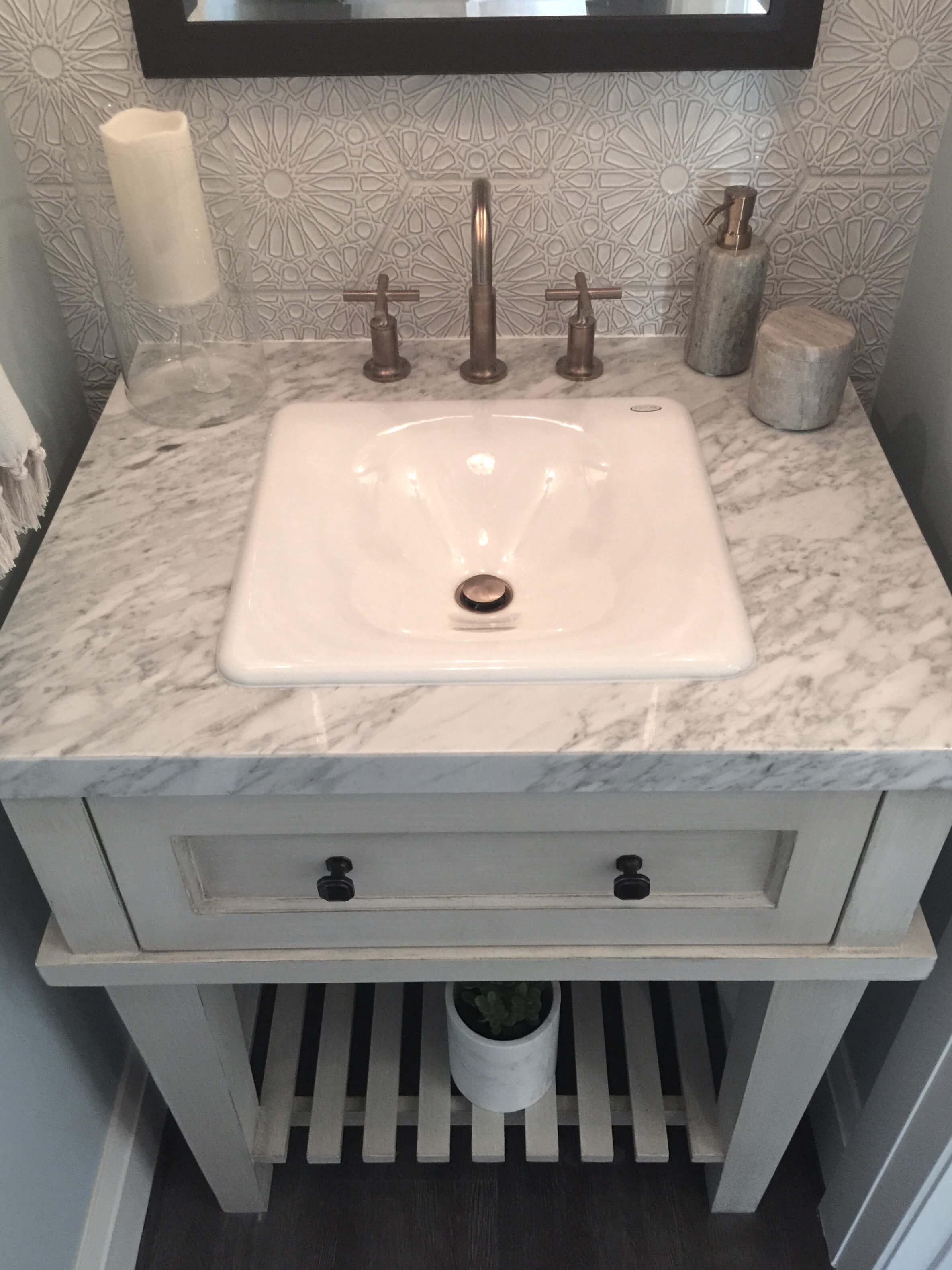 POWDER BATH ROUND UP |Powder bath with textured look tile wall in Guest House | Designer:  Latrice Gentry Brooks,  Chiffon Interiors, Seen at  ASID Showhouse 2017  #powderbath #powderroom