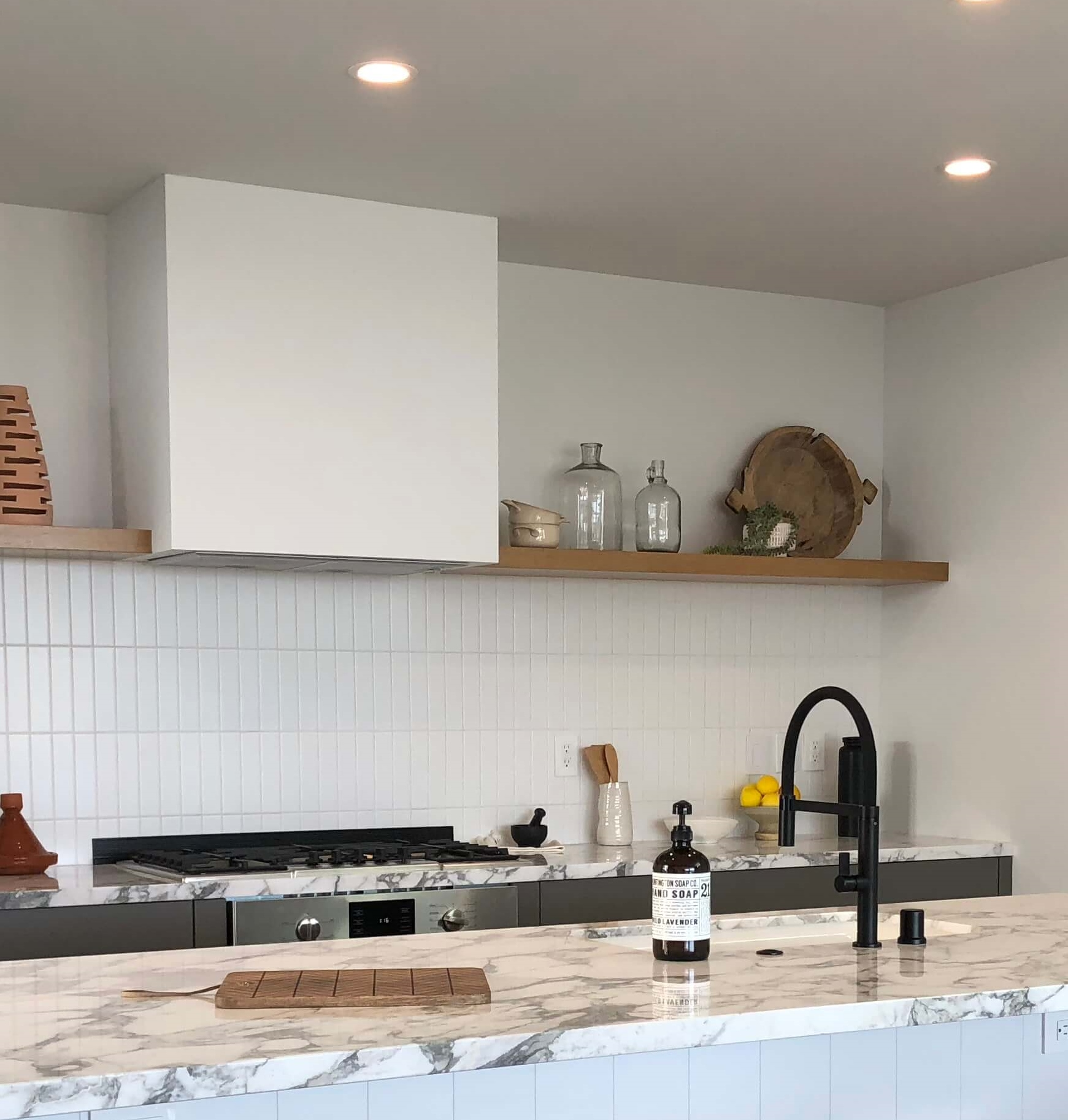 No side splash in this kitchen designed by CHA:COL Architects seen in  Dwell on Design's home tours