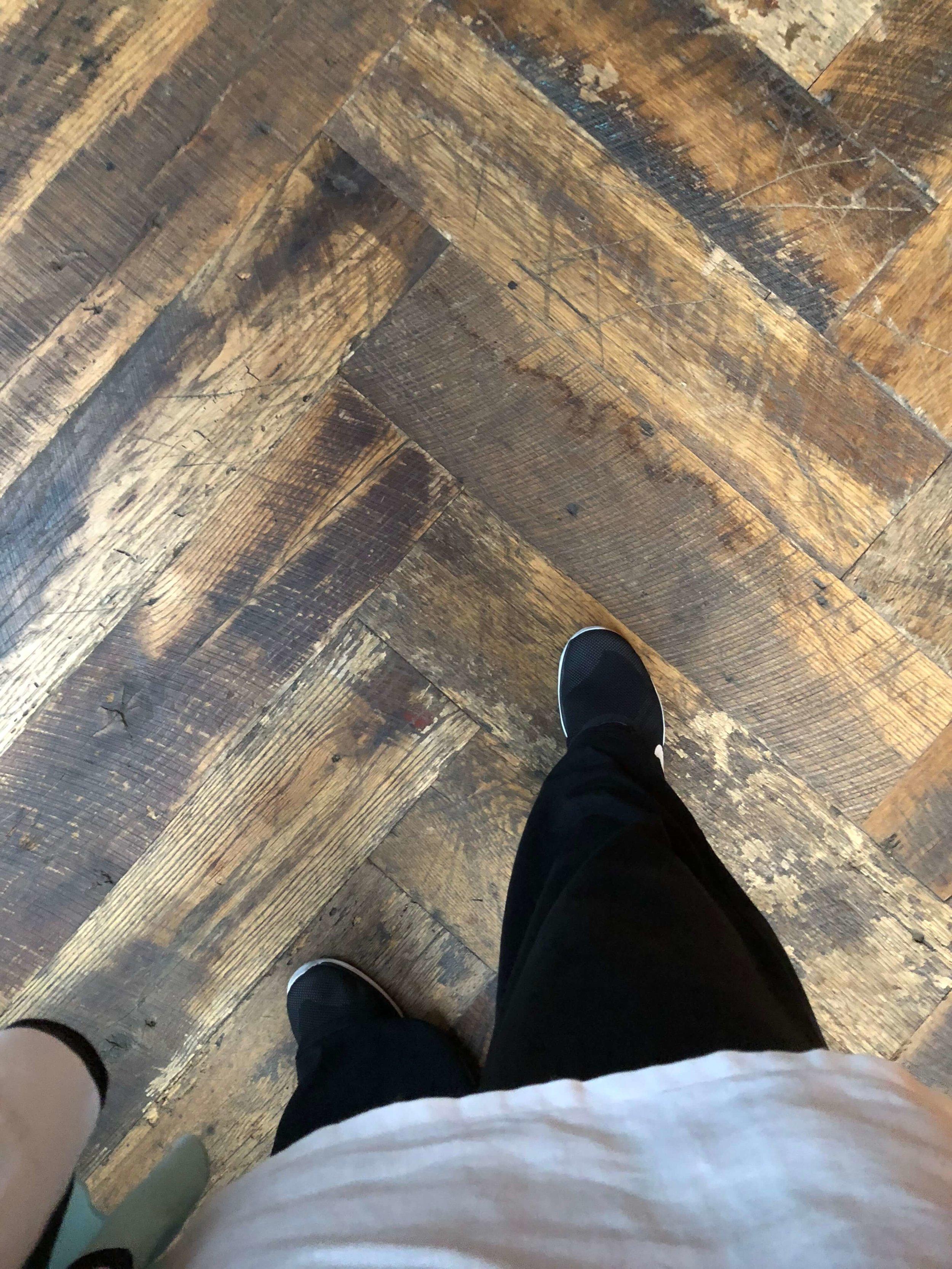 Reclaimed wood boards used as flooring laid in herringbone pattern