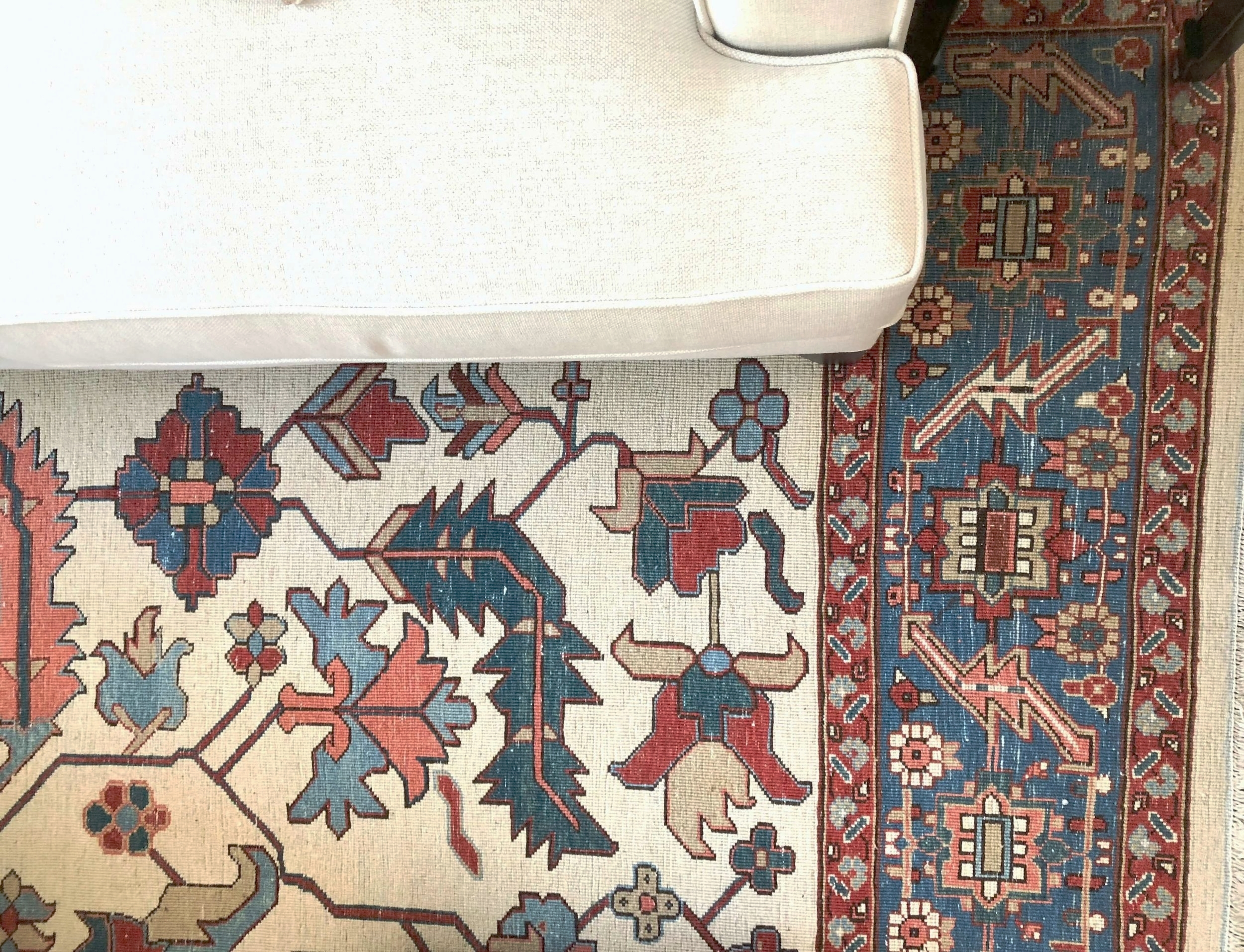 decorating trick to tone down brightly colored rugs