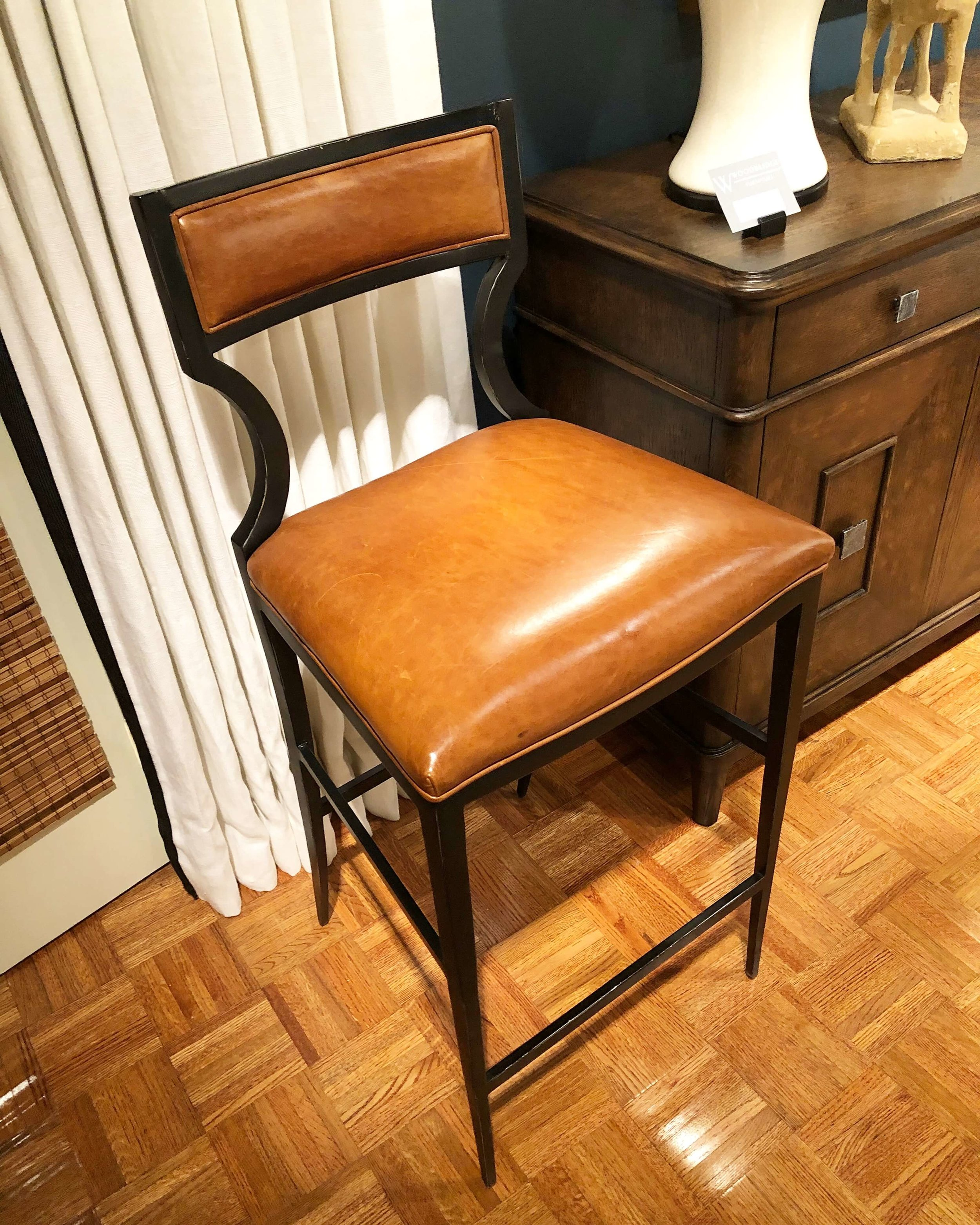 Caramel leather upholstered metal barstool from Woodbridge