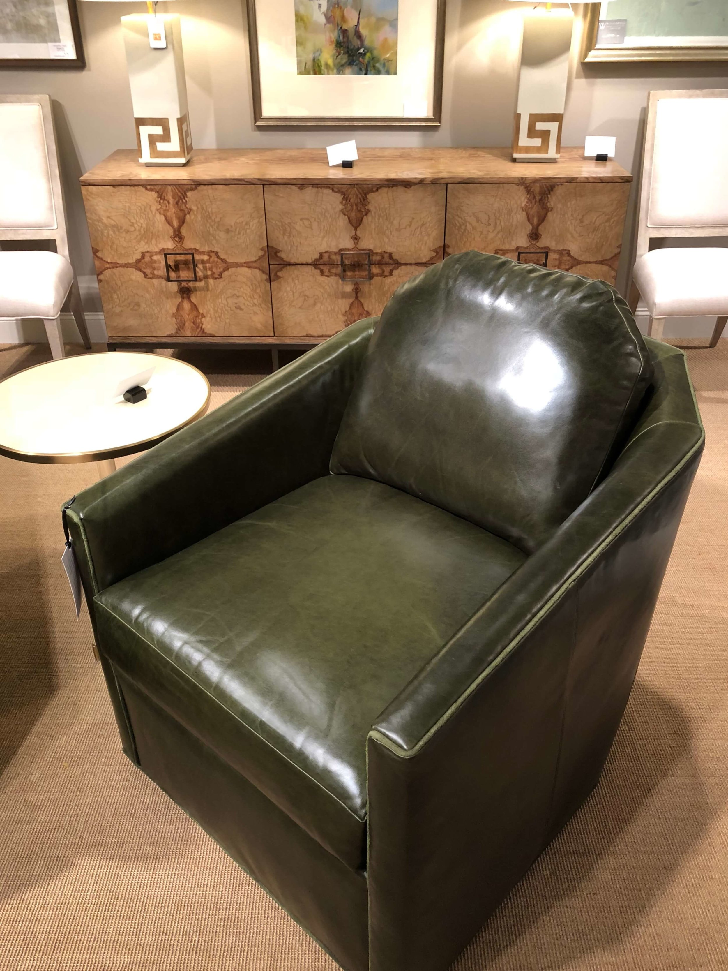 This gorgeous olive green tub chair from CR Laine looks great paired with the warm wood of the console from Woodbridge. That console was one of the finalists for a Pinnacle Award this market.