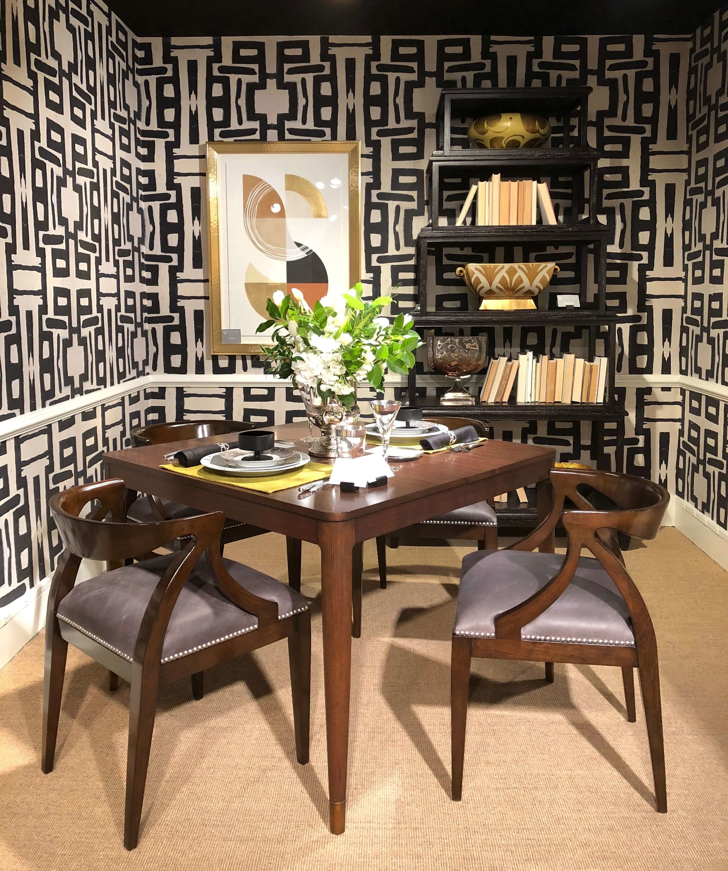This brown wood table and chairs look modern and up to date with the large scale patterned wallcovering enveloping it. Seen at Woodbridge Furniture.