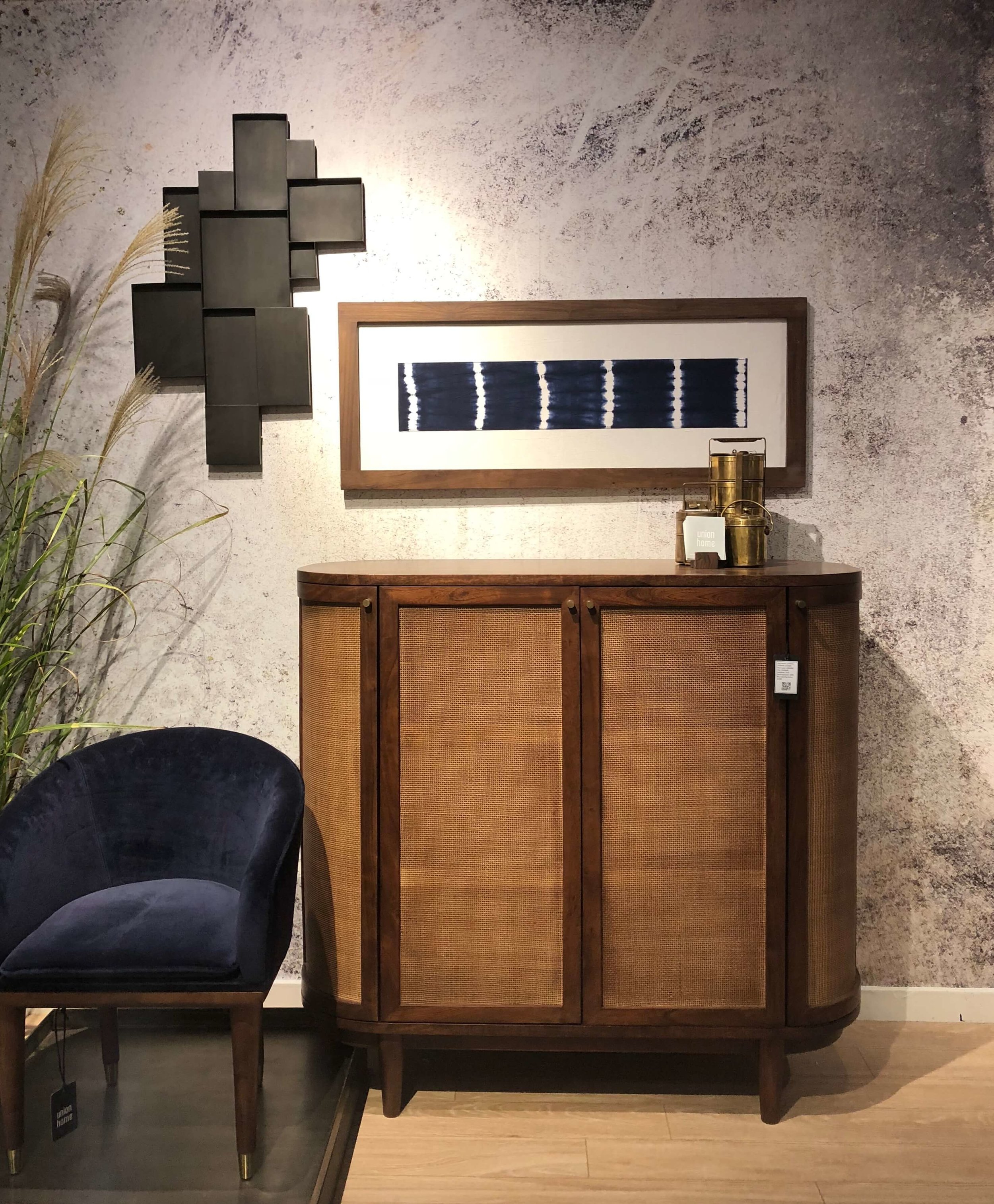 This warm wood console from Union Home incorporates some nice textured panels and look….a tub chair!