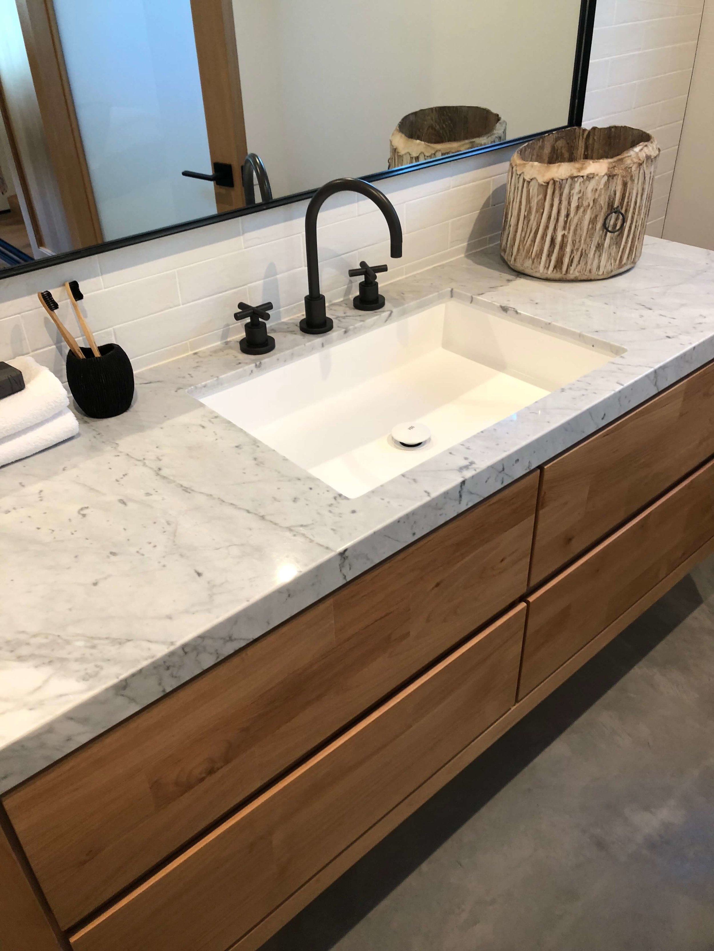 Bathroom vanity in California contemporary home, Dwell on Design's Fall Home Tour, Designer: Vitus Matare #marblevanity #bathroomideas #floatingvanity