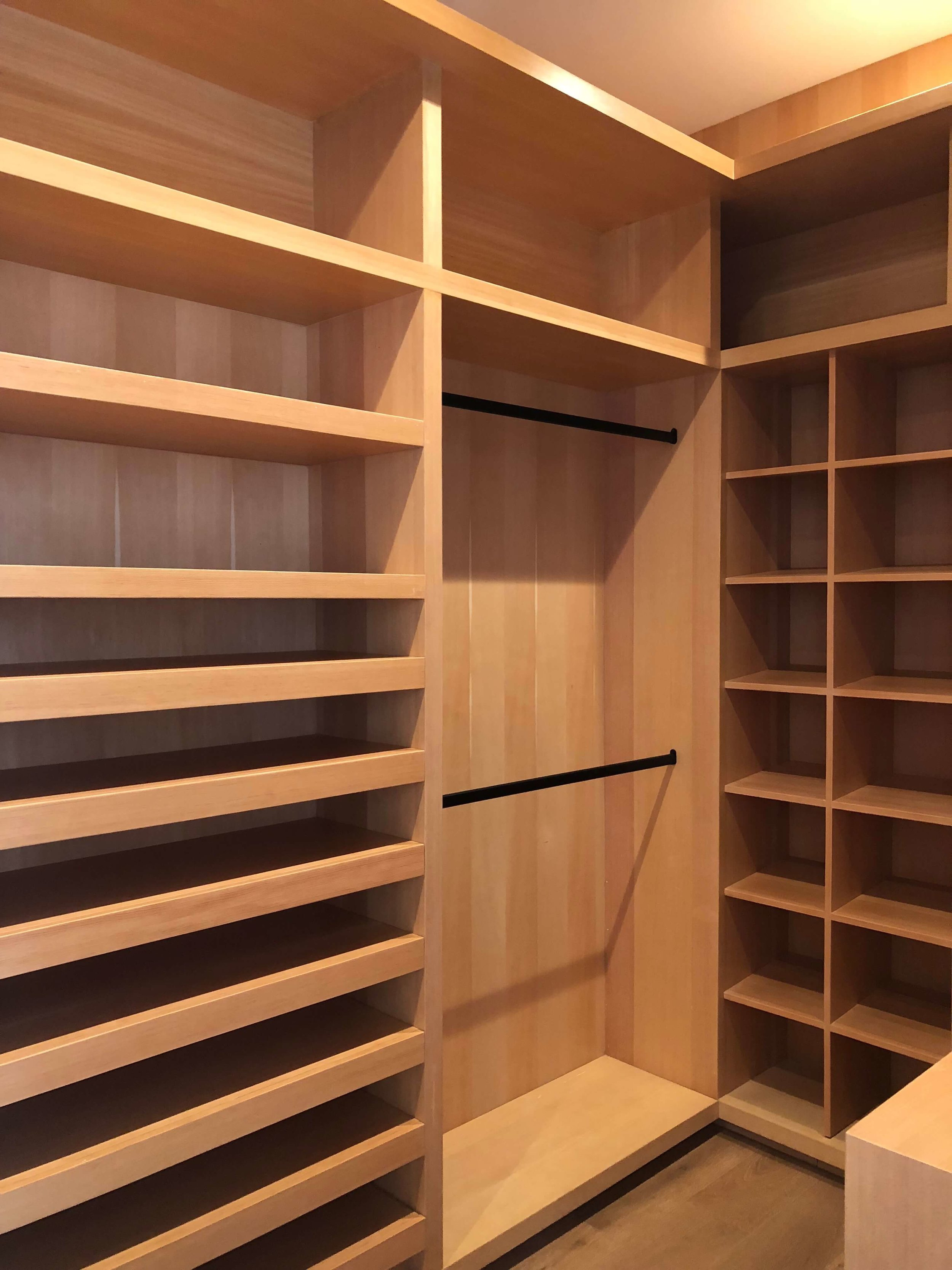 Master closet in natural oak in contemporary home - Dwell on Design's Fall Home Tour, Designer: Vitus Matare #closet #cabinetry #closetdesign