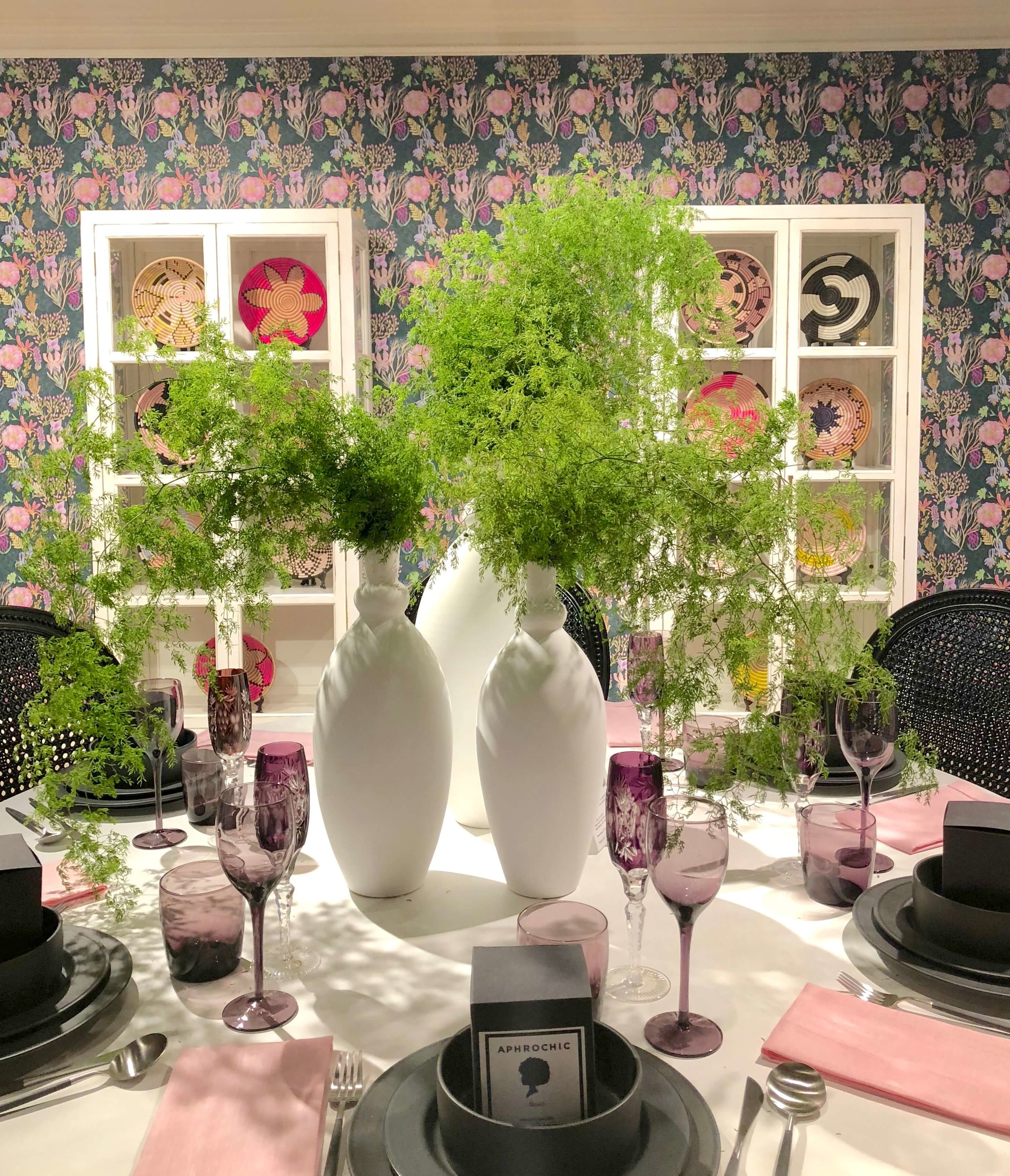 Beautiful greens as the centerpiece in dining room designed by Aphrochic for the Alden Parkes showroom | #centerpiece #floralarrangement #tabletop #tablesetting