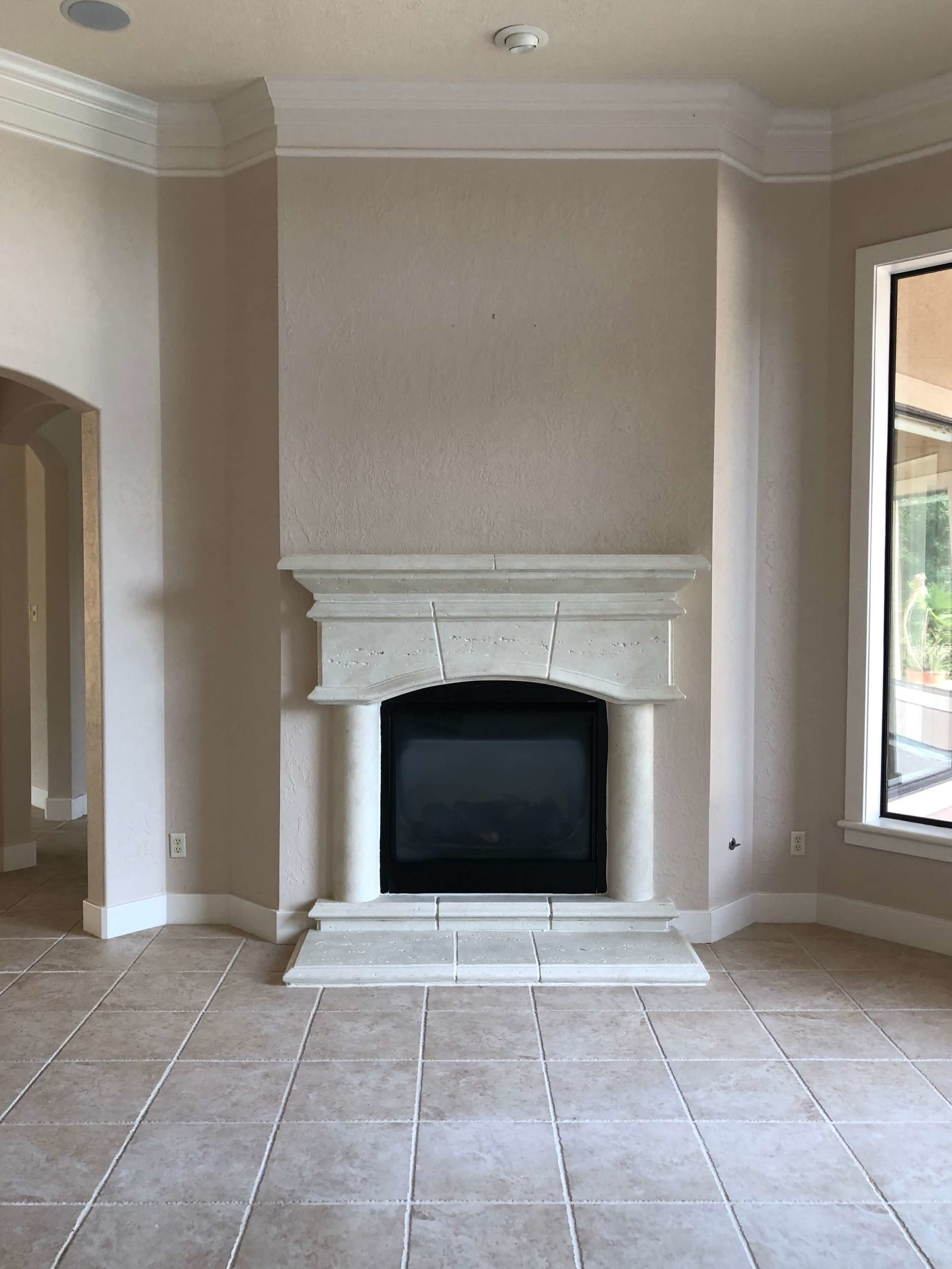 BEFORE REMODEL - Living room fp with chunky mouldings and pinkish mauve wall color