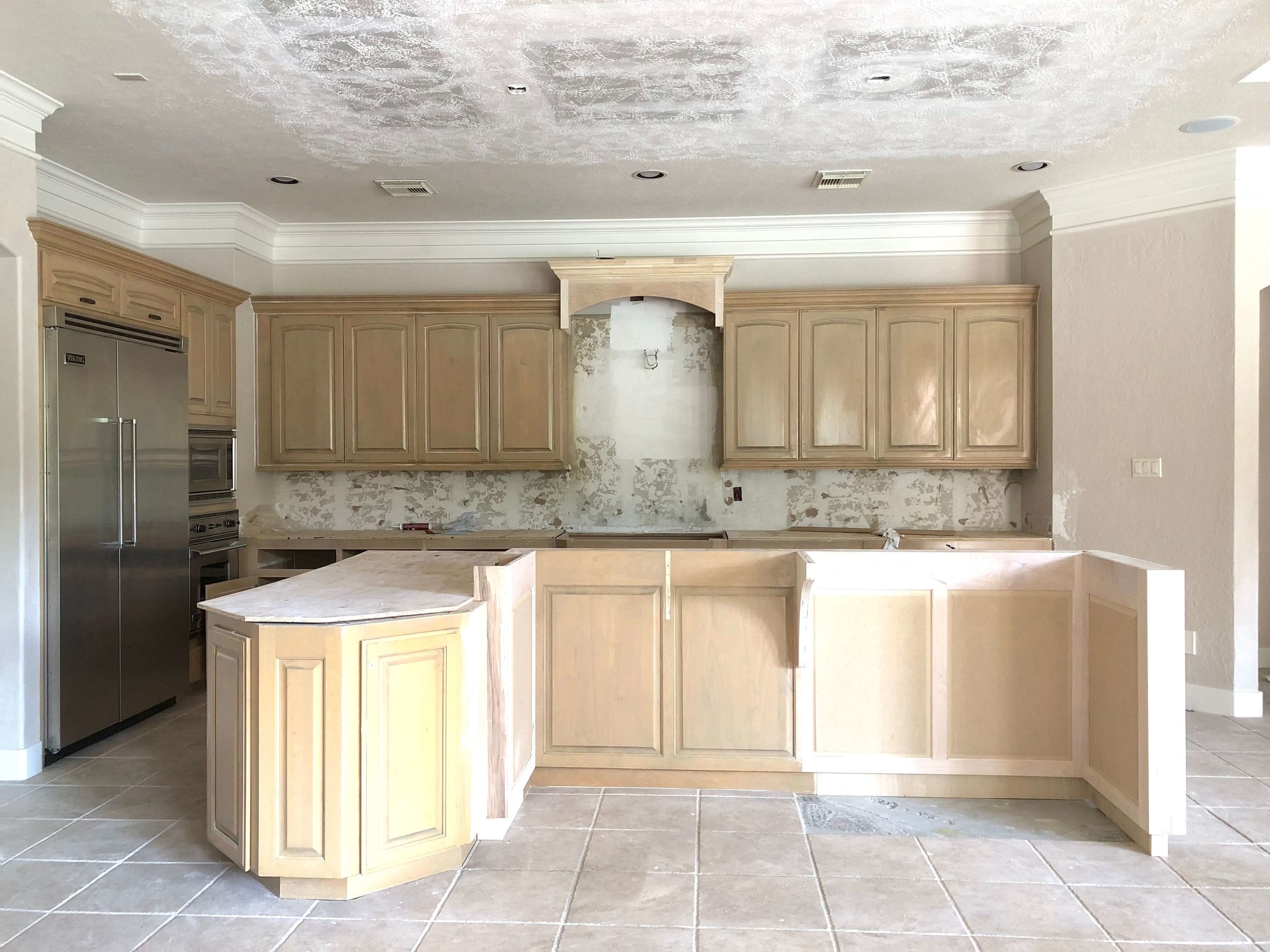 REMODEL IN PROGRESS - cabinetry modifications and furr down over island removed | Carla Aston, Designer #kitchenremodel