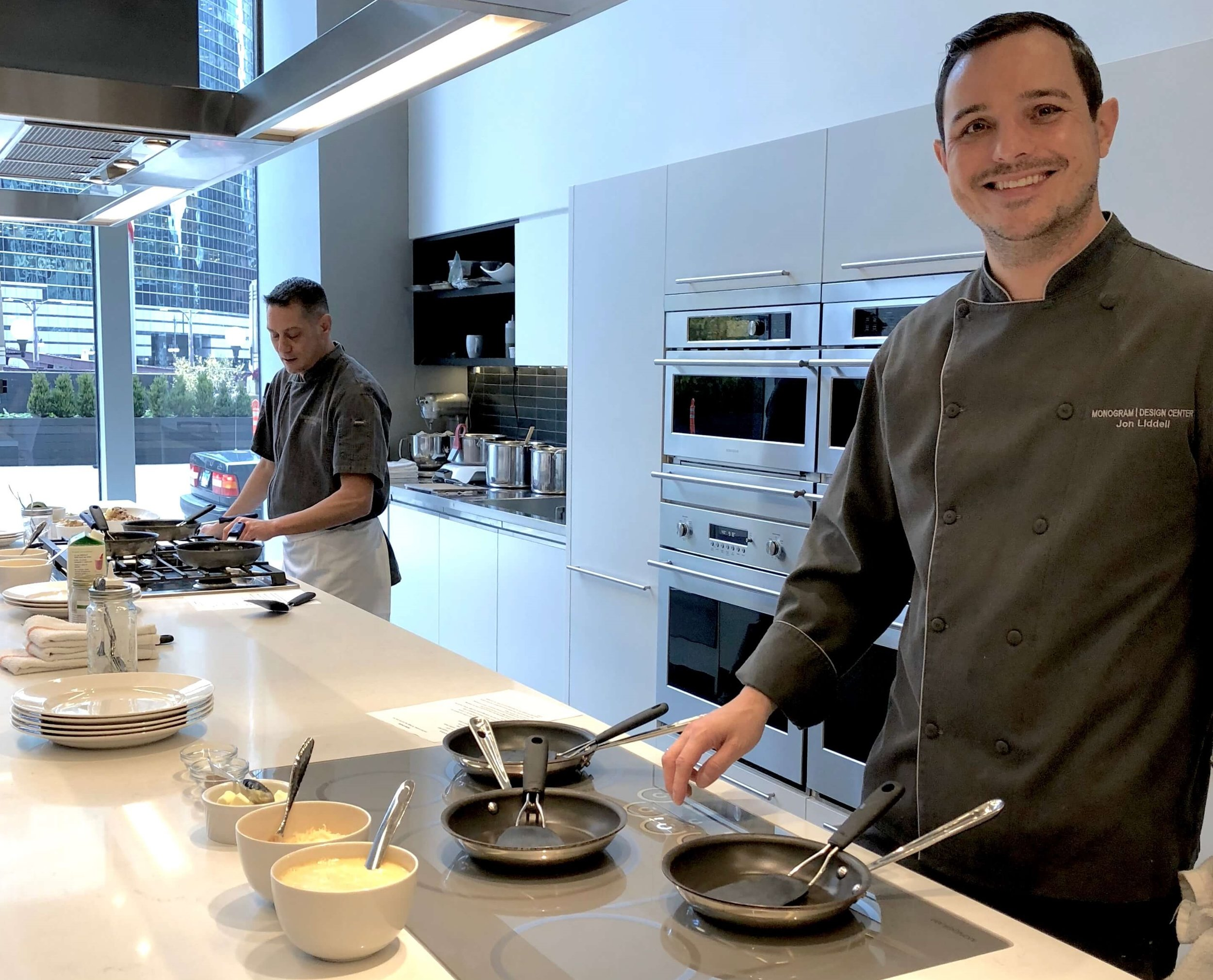 Chef Jon at the Chicago Monogram Appliances showroom, demonstrating how to improve your cooking skills using these luxury kitchen appliances.