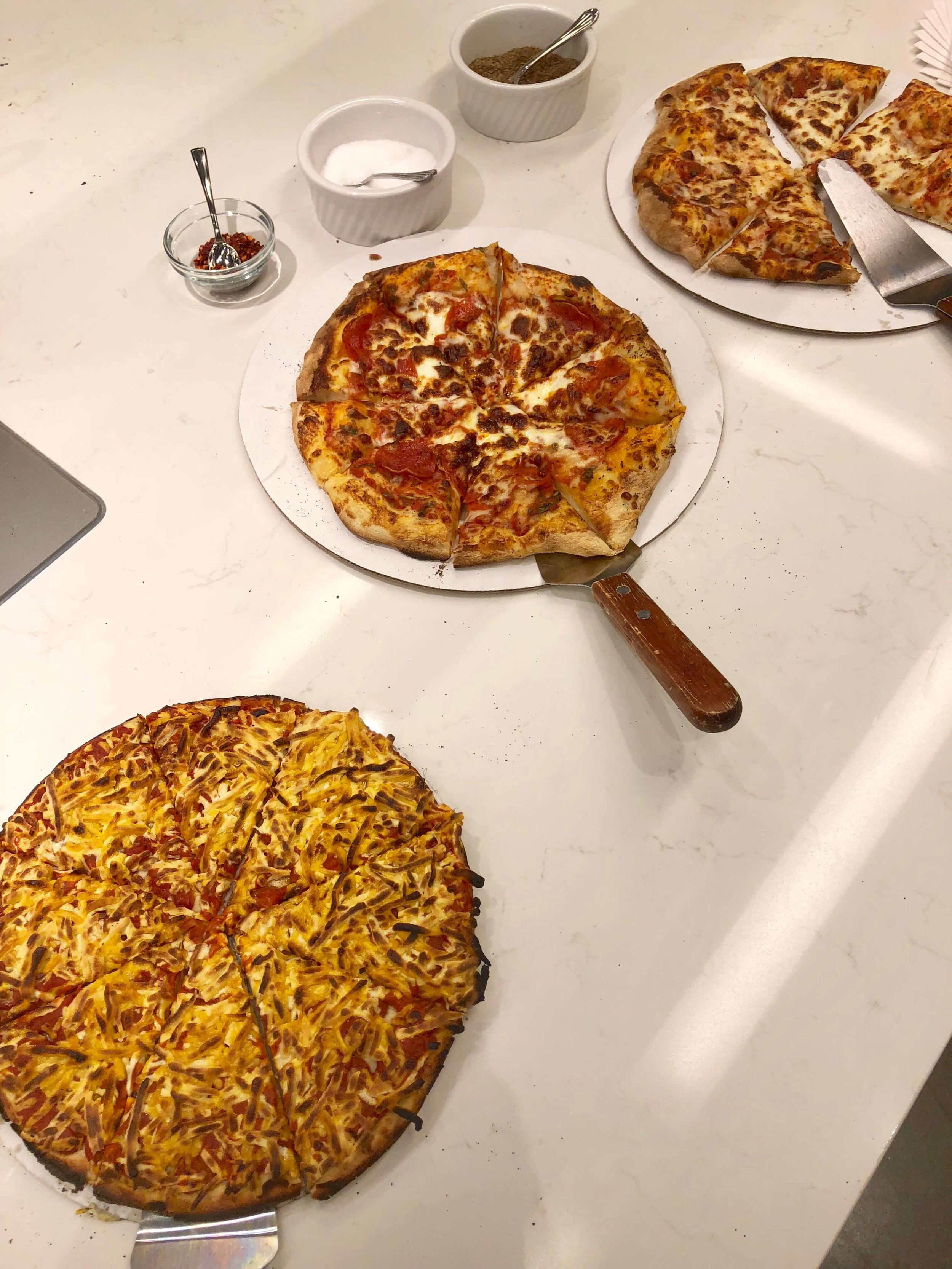 Cooking with a chef at Monogram Appliances showroom #monogramappliances #pizzaoven #indoorpizzaoven