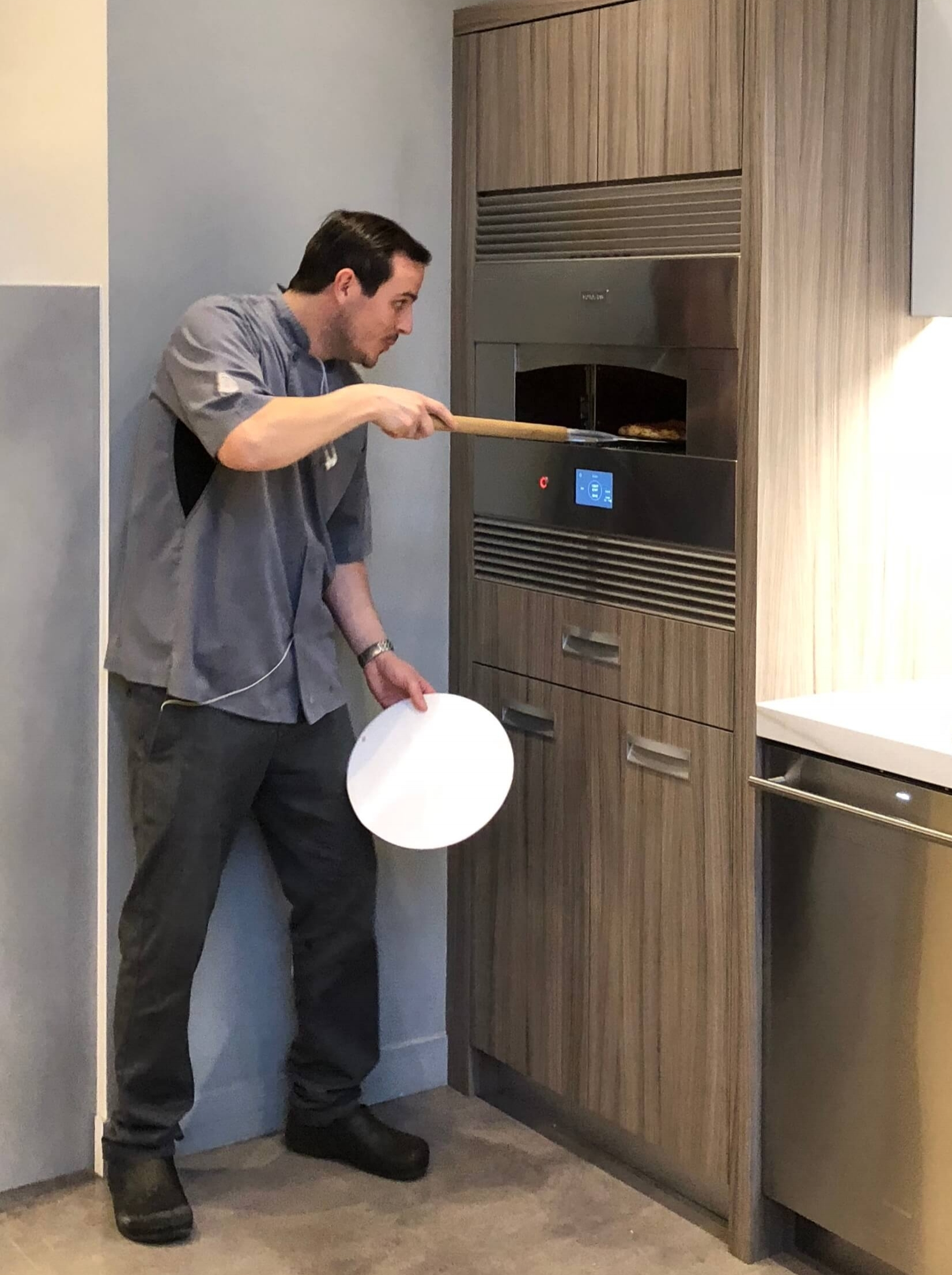 Cooking with a chef at Monogram Appliances showroom #pizzaoven #monogramappliances #indoorpizzaoven