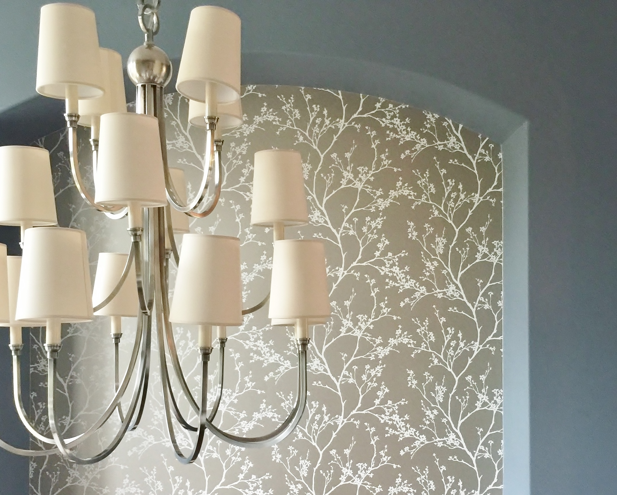 IN PROGRESS - polished nickel chandelier with gold wallpaper beyond