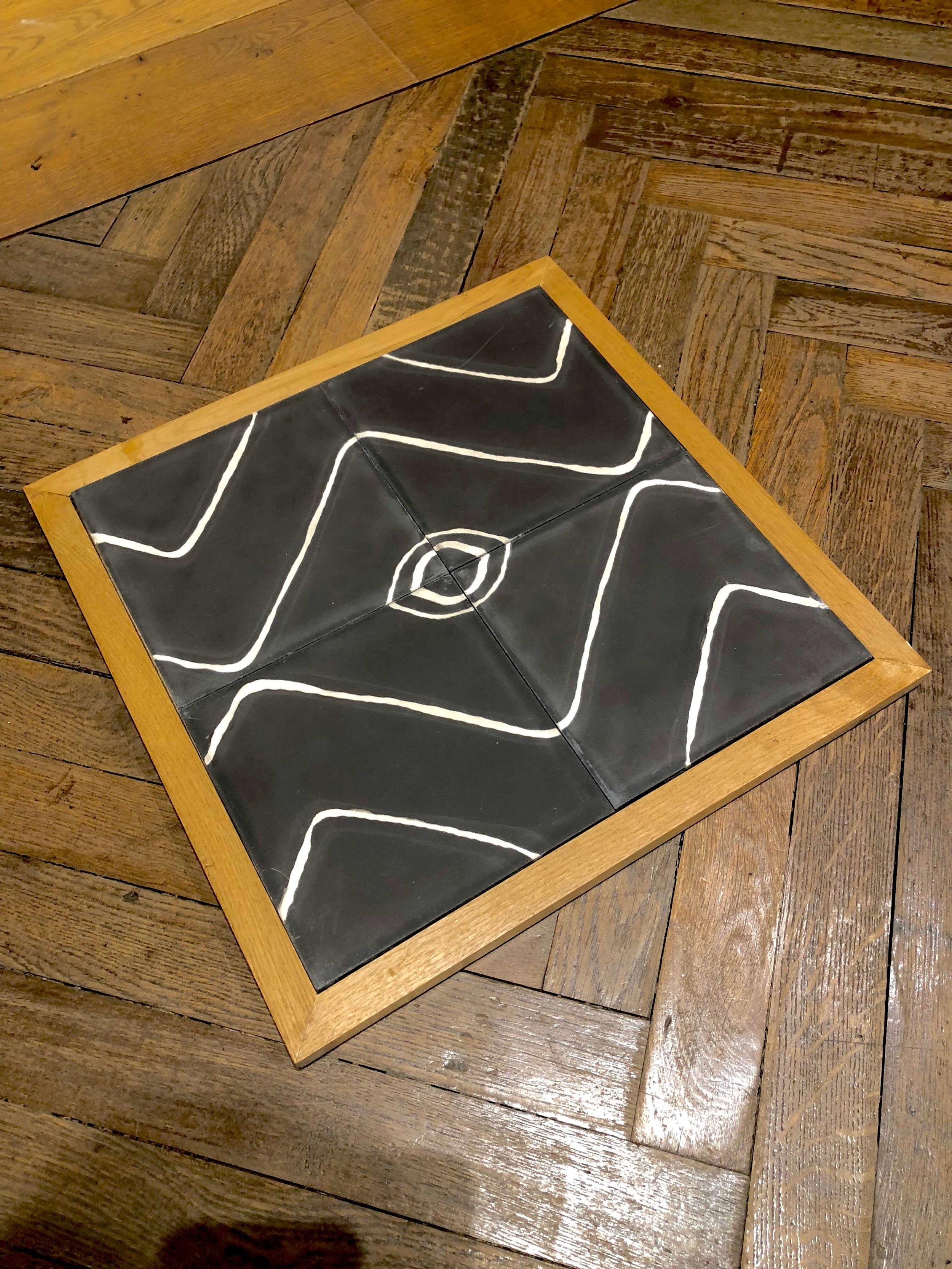 Concrete tile designed by Commune Design at Exquisite Surfaces - Merchandise Mart, Chicago #concretetile #tilepattern