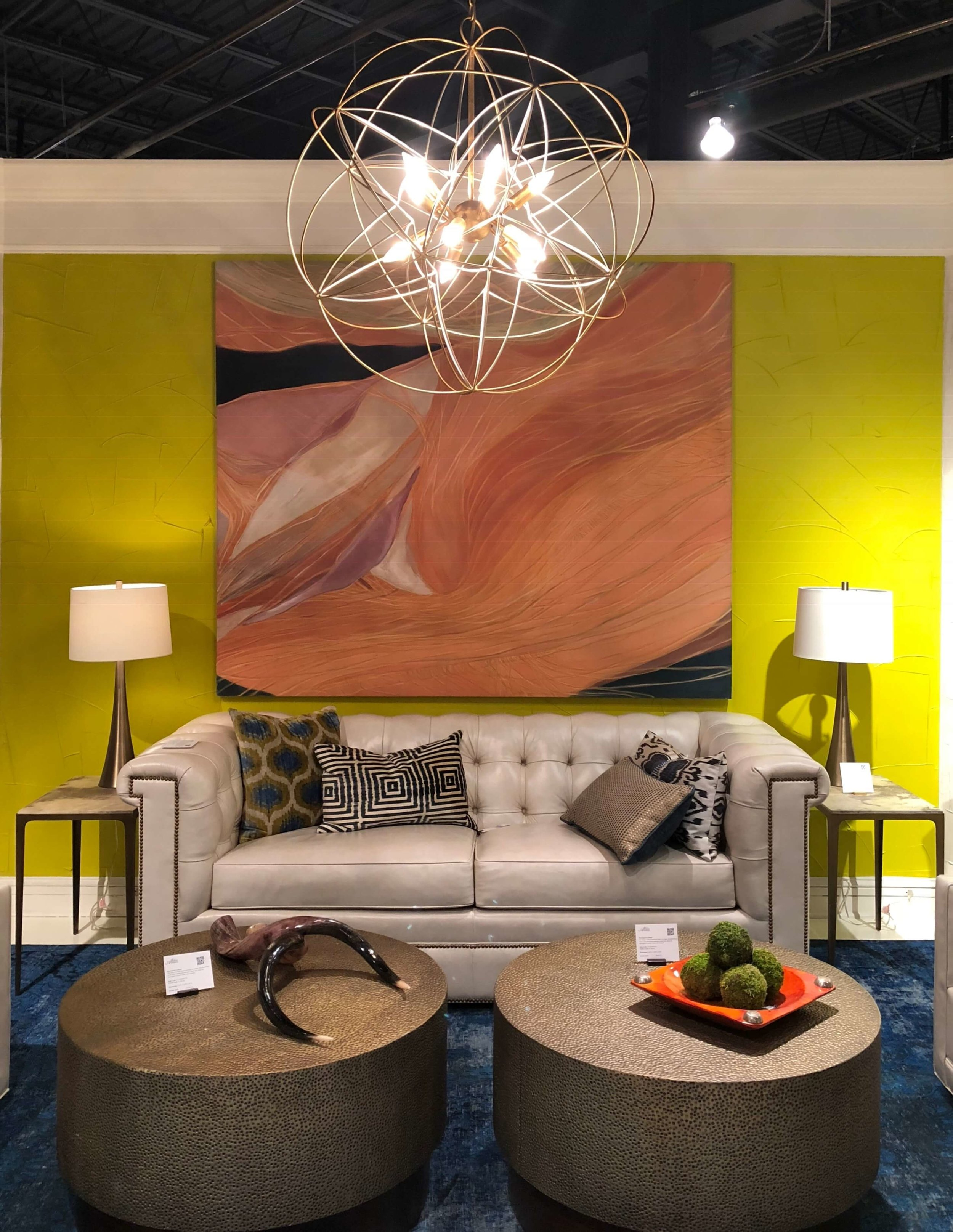 Living room designed by Jeanne Chung of Cozy, Stylish, Chic for Alden Parkes Showroom #hpmkt #yellowwall #livingroomideas #chesterfieldsofa