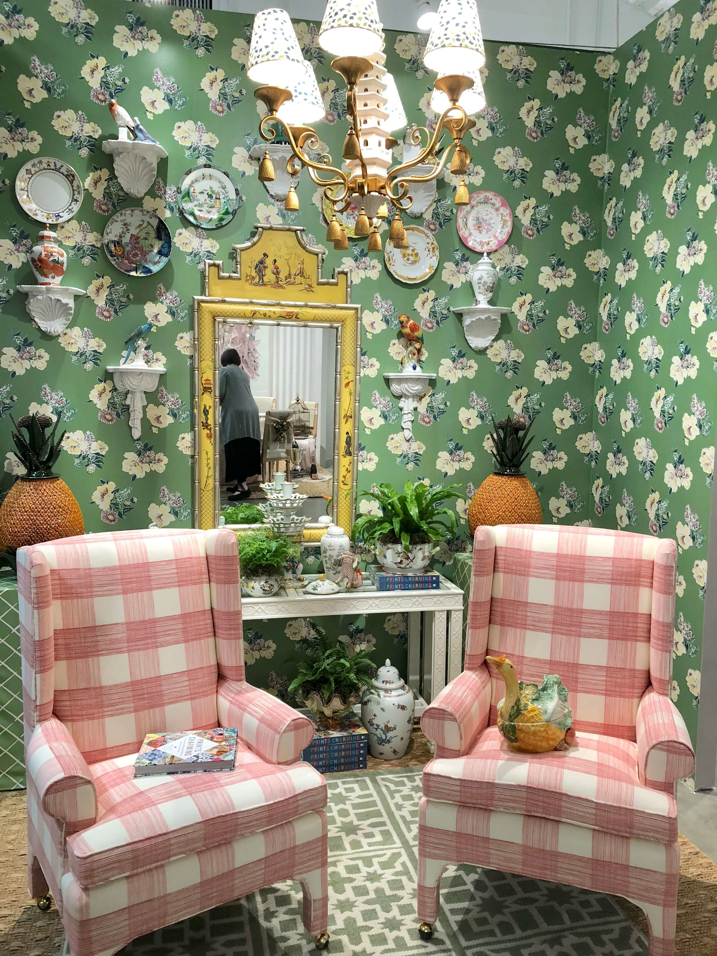 Pink and green sitting room designed by Madcap Cottage for Replacements, Ltd.   #platewall #wallpaper #wingbackchair #floralwallpaper #hpmkt