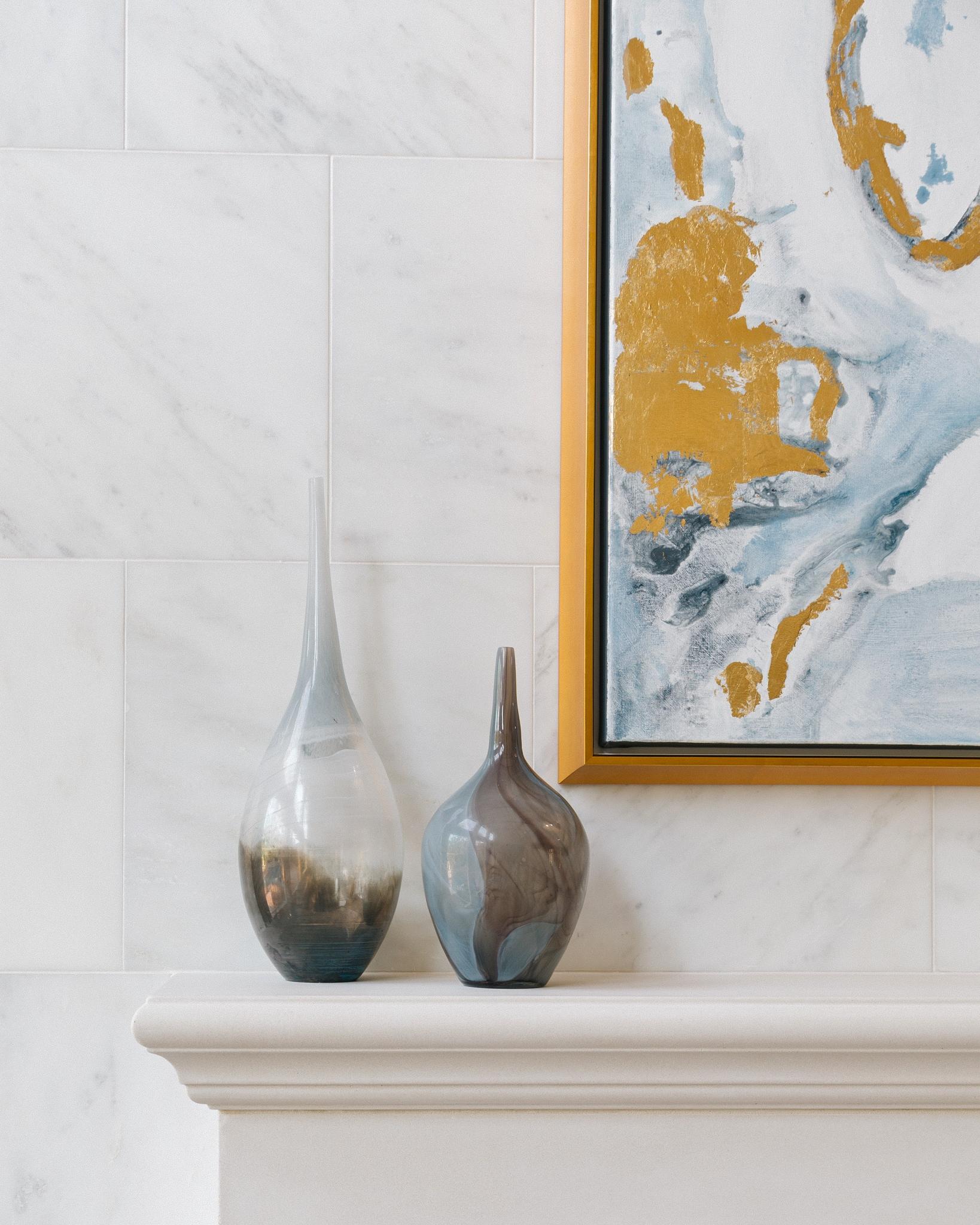 Fireplace mantel with art and art glass vases | Designer: Carla Aston, Photographer: Colleen Scott #living room #livingroomideas #fireplacemantel #fireplace #vases #homedecor
