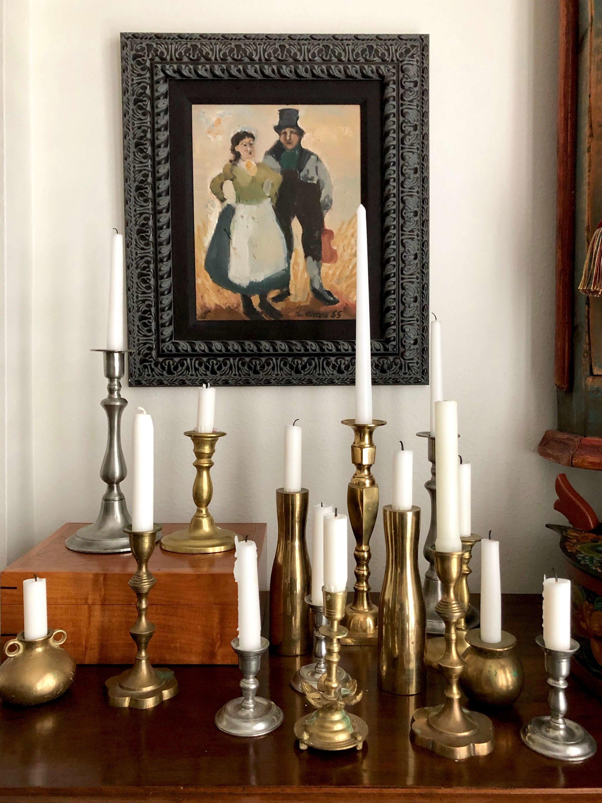 Taper candles trending in home design with brass and pewter candlesticks #tapercandles #candlesticks #interiordesigntrends #trending