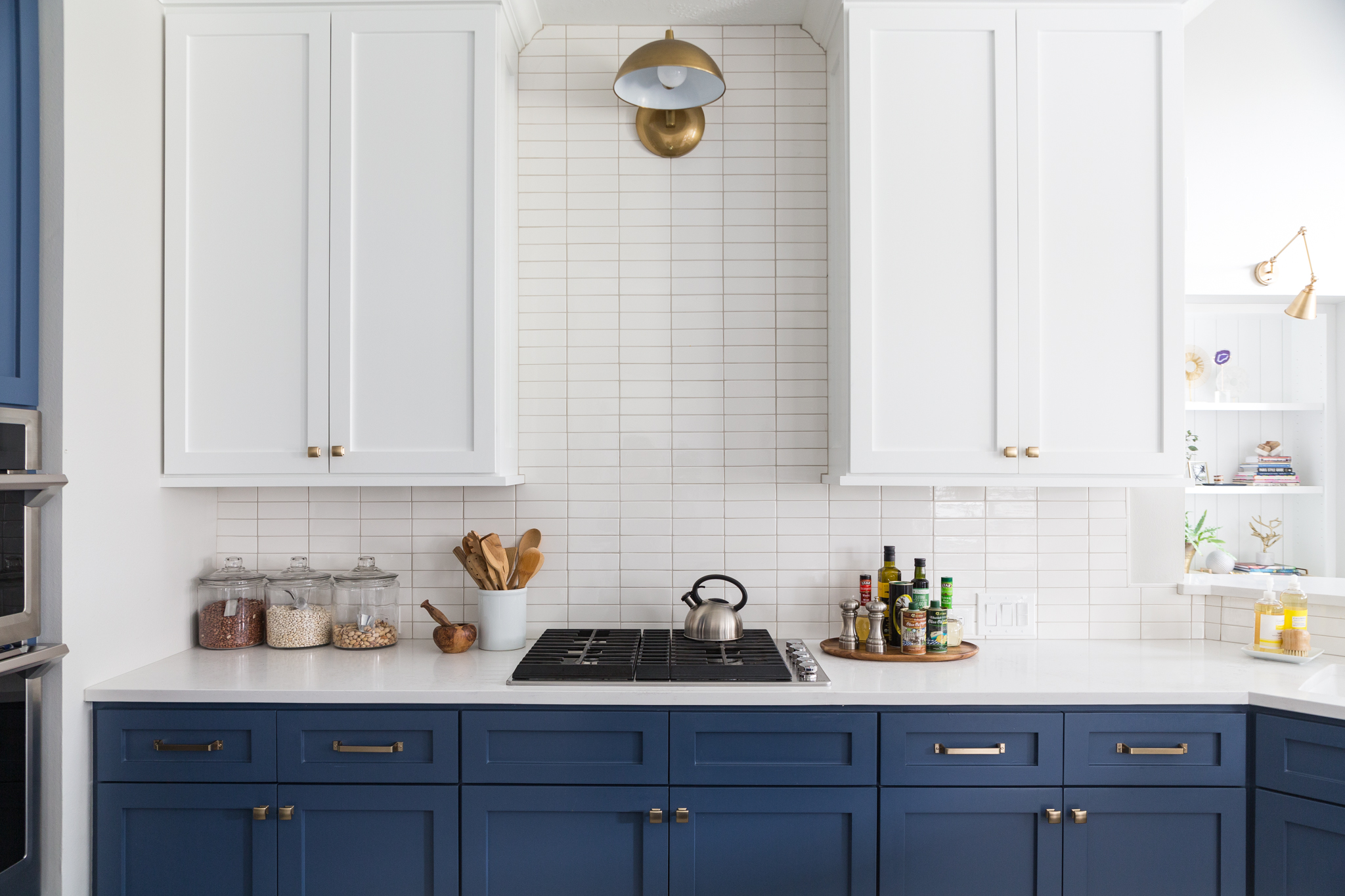 BEFORE AND AFTER - A navy and white kitchen remodel | Carla Aston, Designer | Colleen Scott, Photographer #kitchenremodel #navyandwhitekitchen #kitchenideas