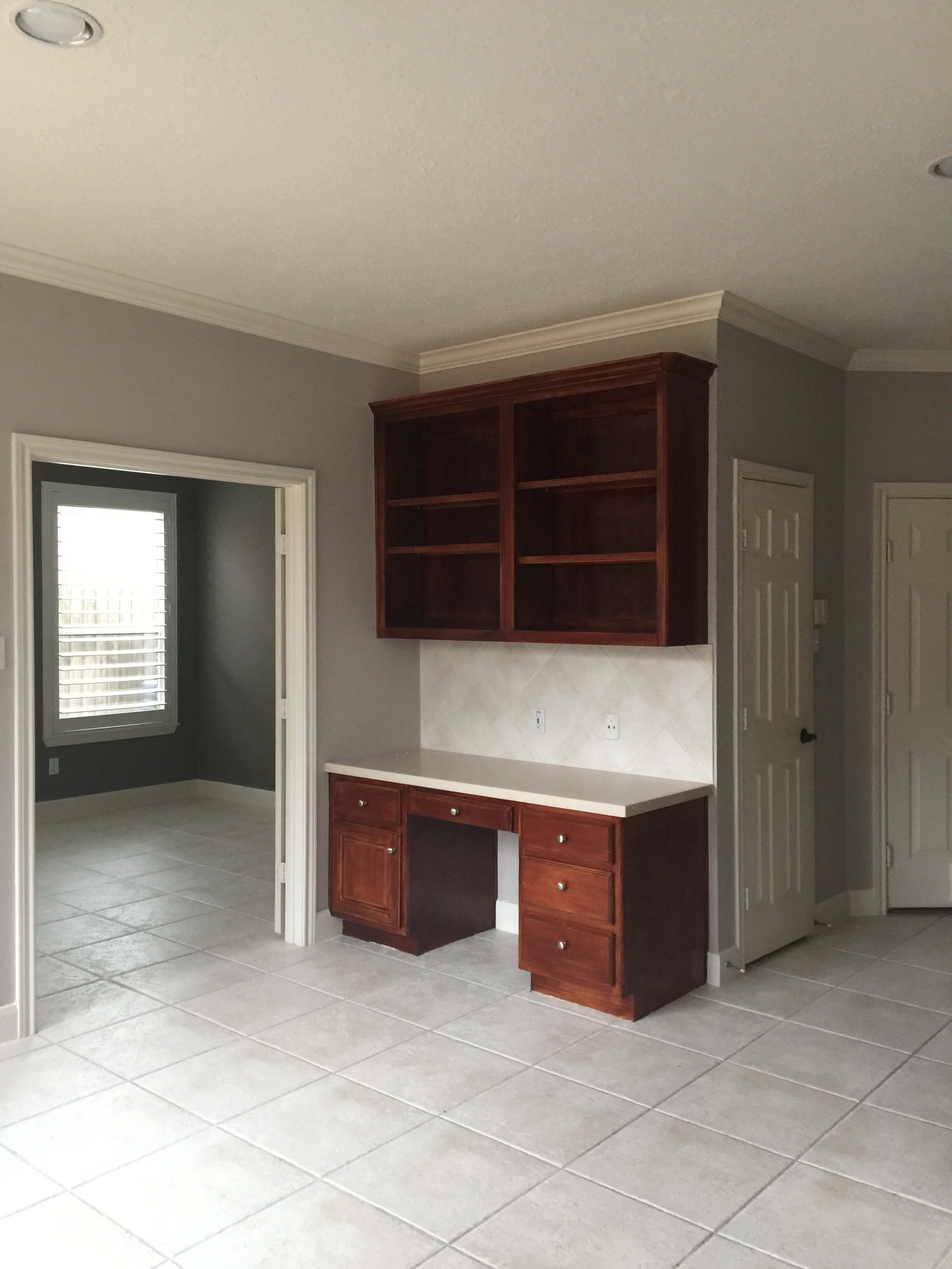 BEFORE - Kitchen Remodel with built-in desk to be removed to include a new mudroom bench