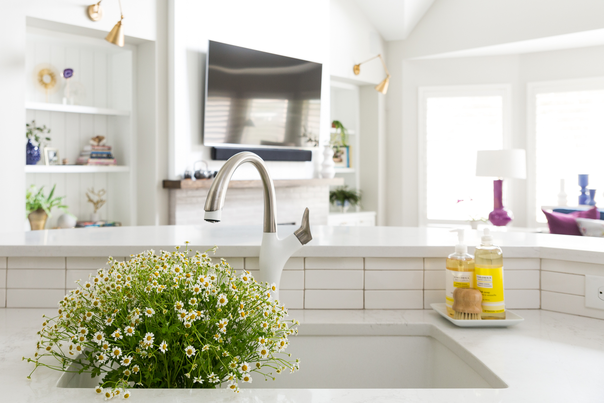 BEFORE AND AFTER - A navy and white kitchen remodel w/ white faucet | Carla Aston, Designer | Colleen Scott, Photographer