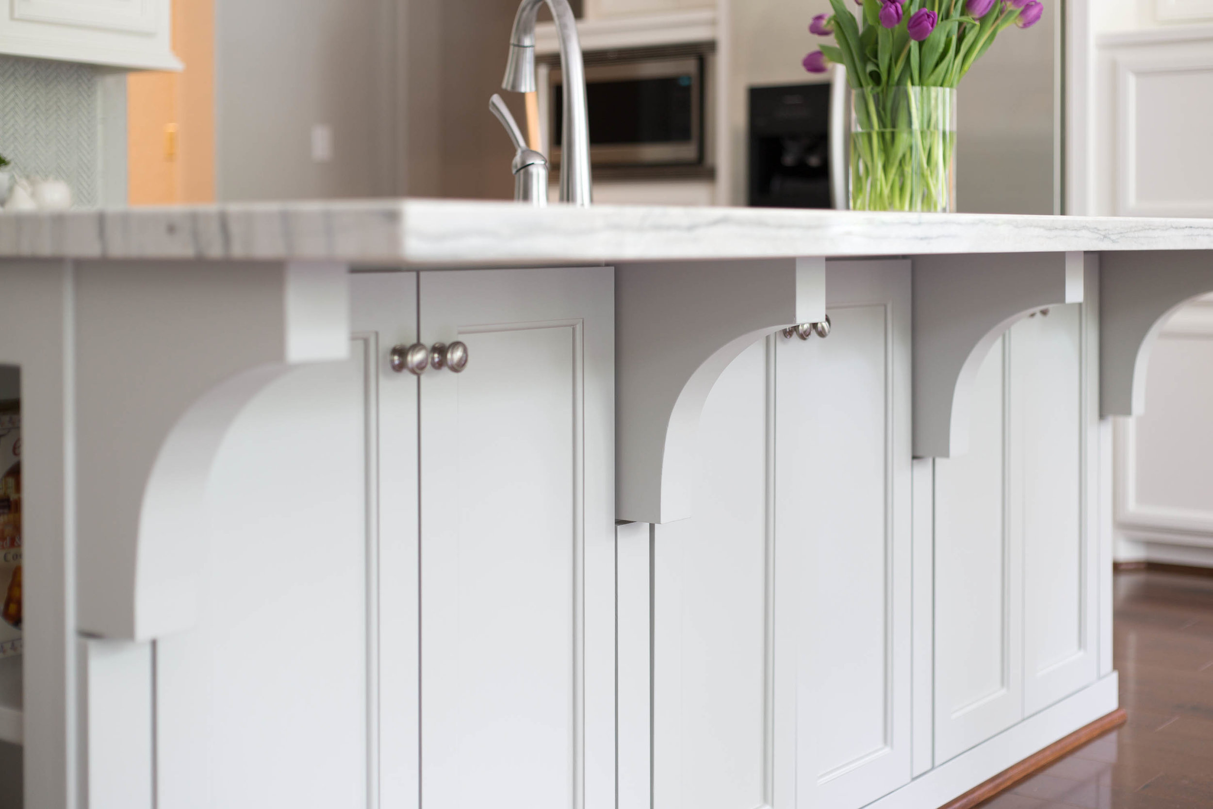 What To Upgrade In Your New Builder Home And What NOT To | Simple cabinet door details on kitchen island