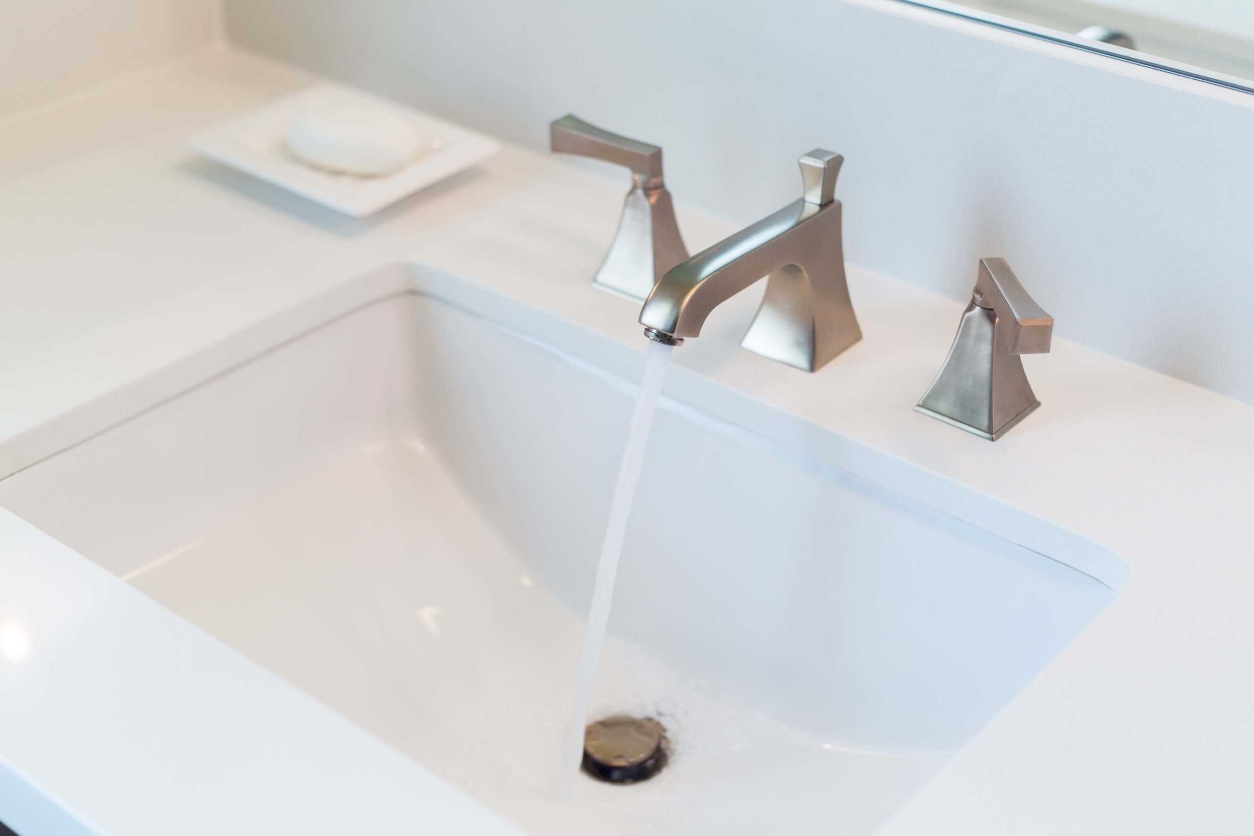 What to Upgrade In Your New Builder Home And What NOT To | bathroom faucet