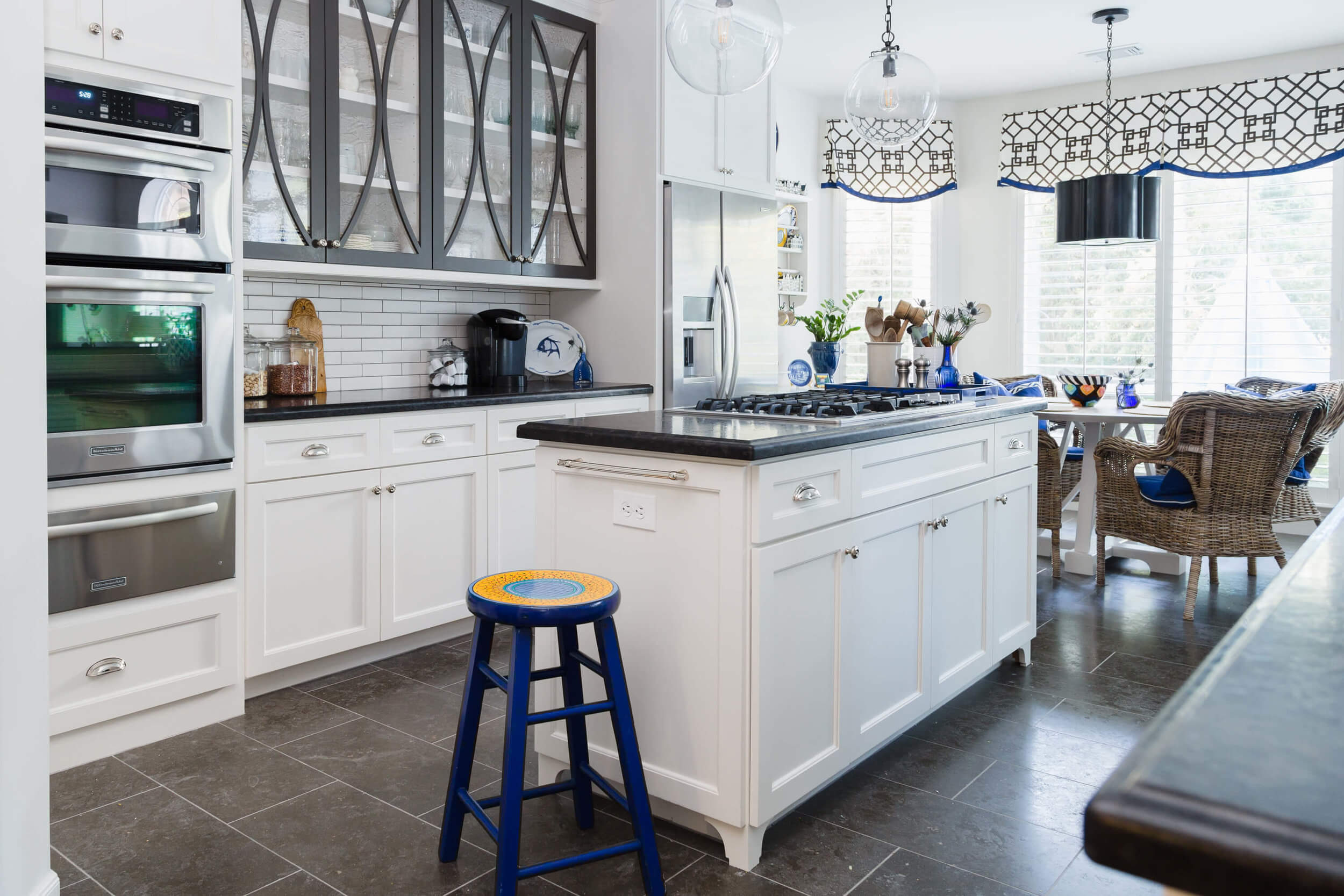 What to Upgrade In Your New Builder Home And What NOT To | Kitchen with Marron Cohiba granite countertops | Carla Aston, Designer